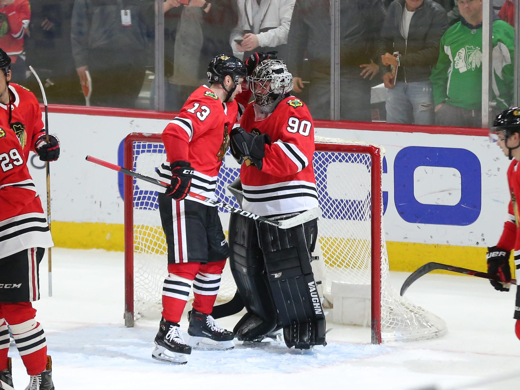 March 29: Emergency goalie Scott Foster (90) is congratulated after closing out the Chicago Blackhawks' win over the Winnipeg Jets.