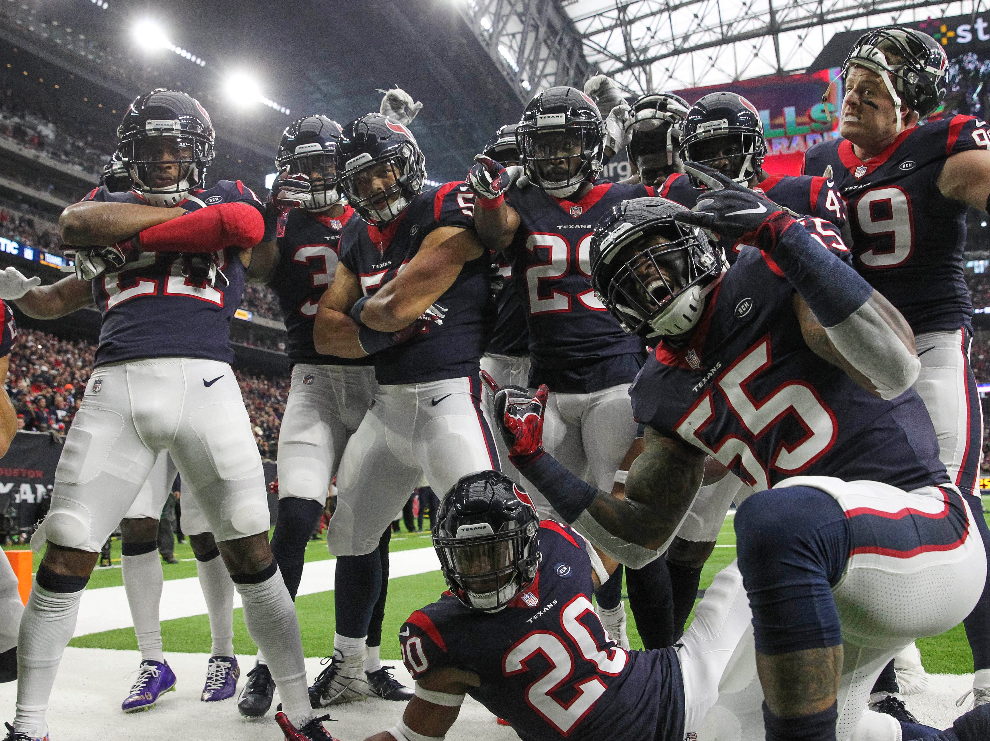 Texans players celebrate after an interception in the second quarter against the Colts.