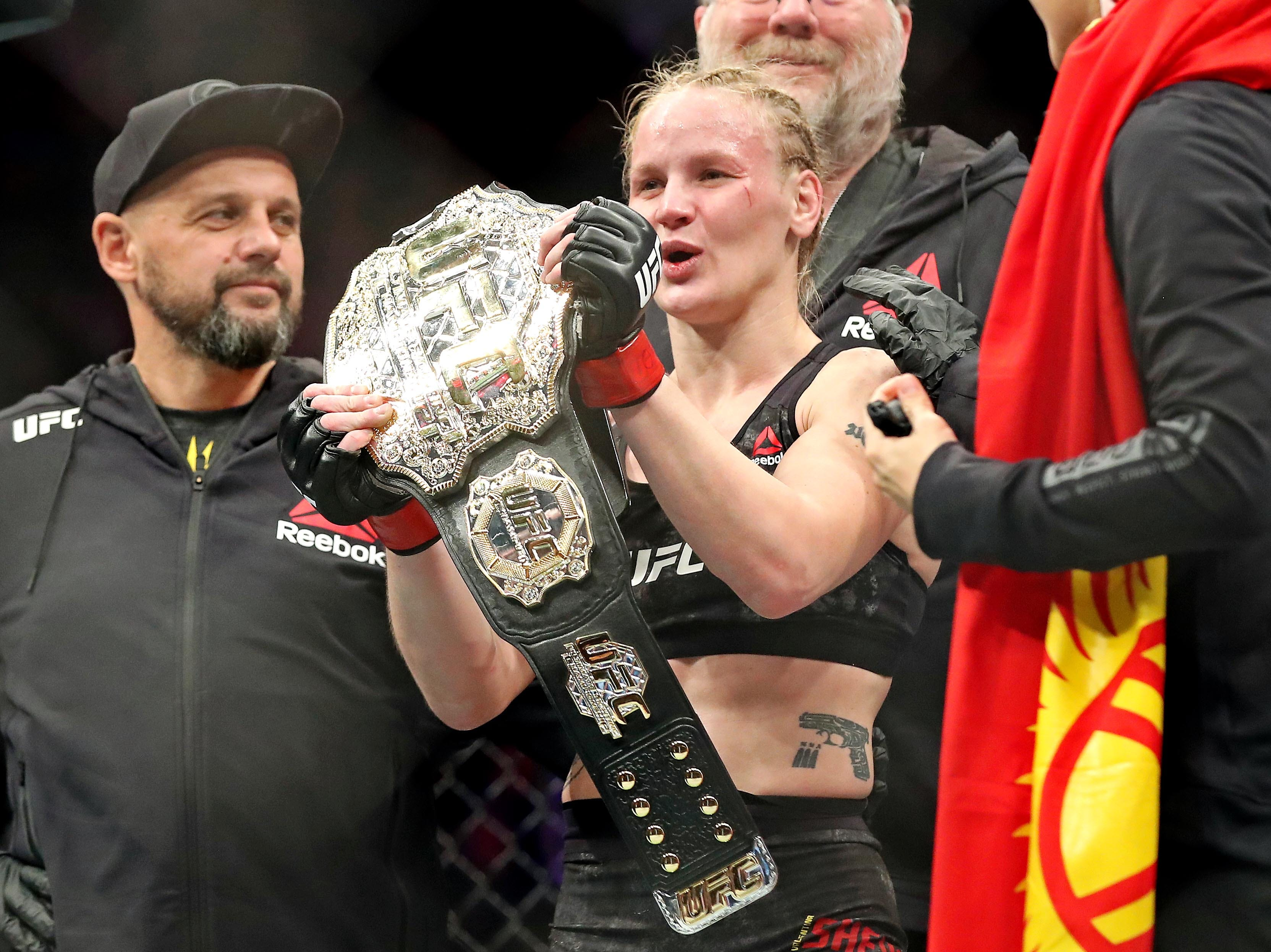 Valentina Shevchenko (red gloves) celebrates after beating Joanna Jedrzejczyk (blue gloves) during UFC 231 at Scotiabank Arena.