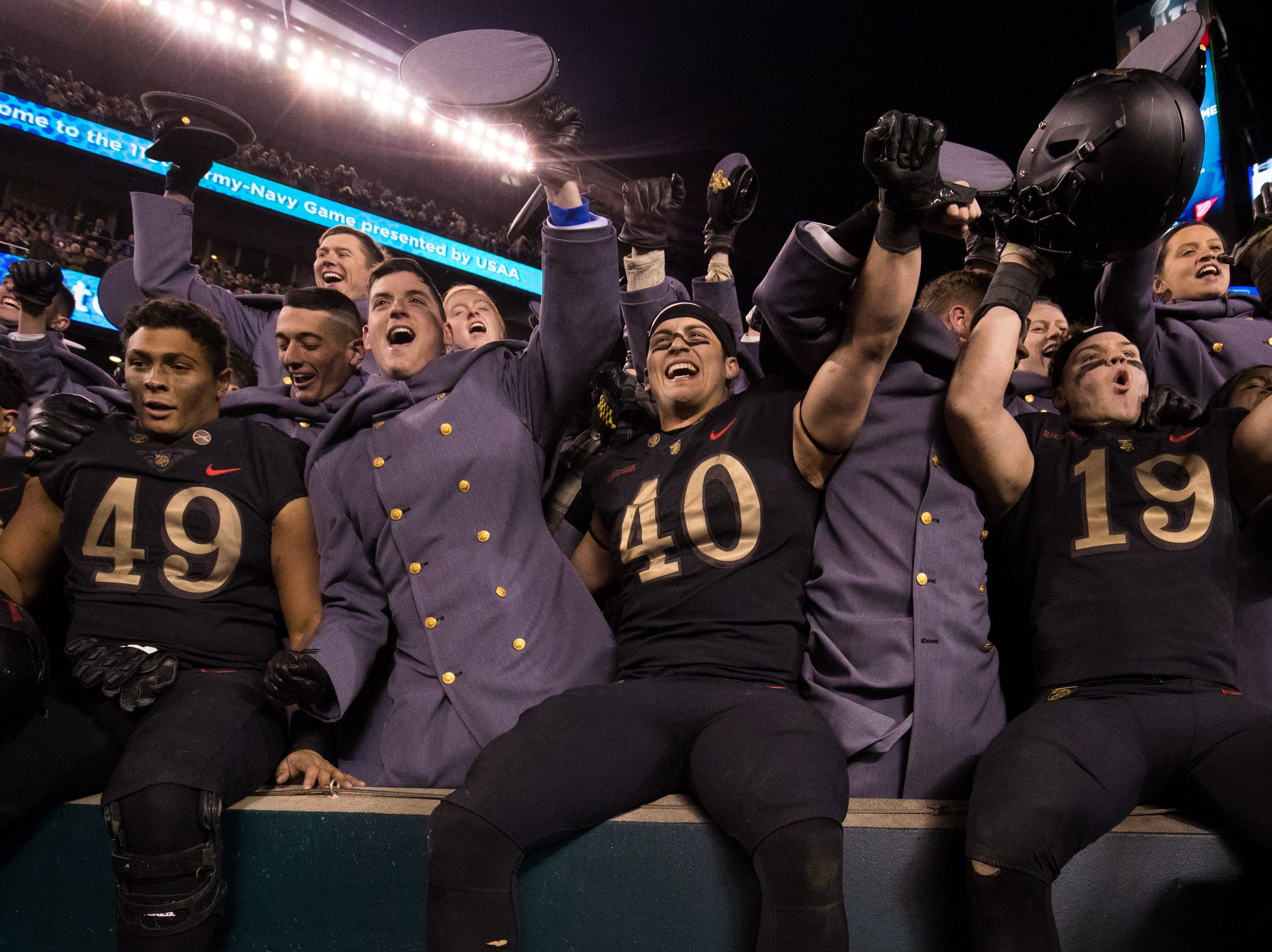 The Army Black Knights celebrate with cadets after a victory against the Navy Midshipmen at Lincoln Financial Field.