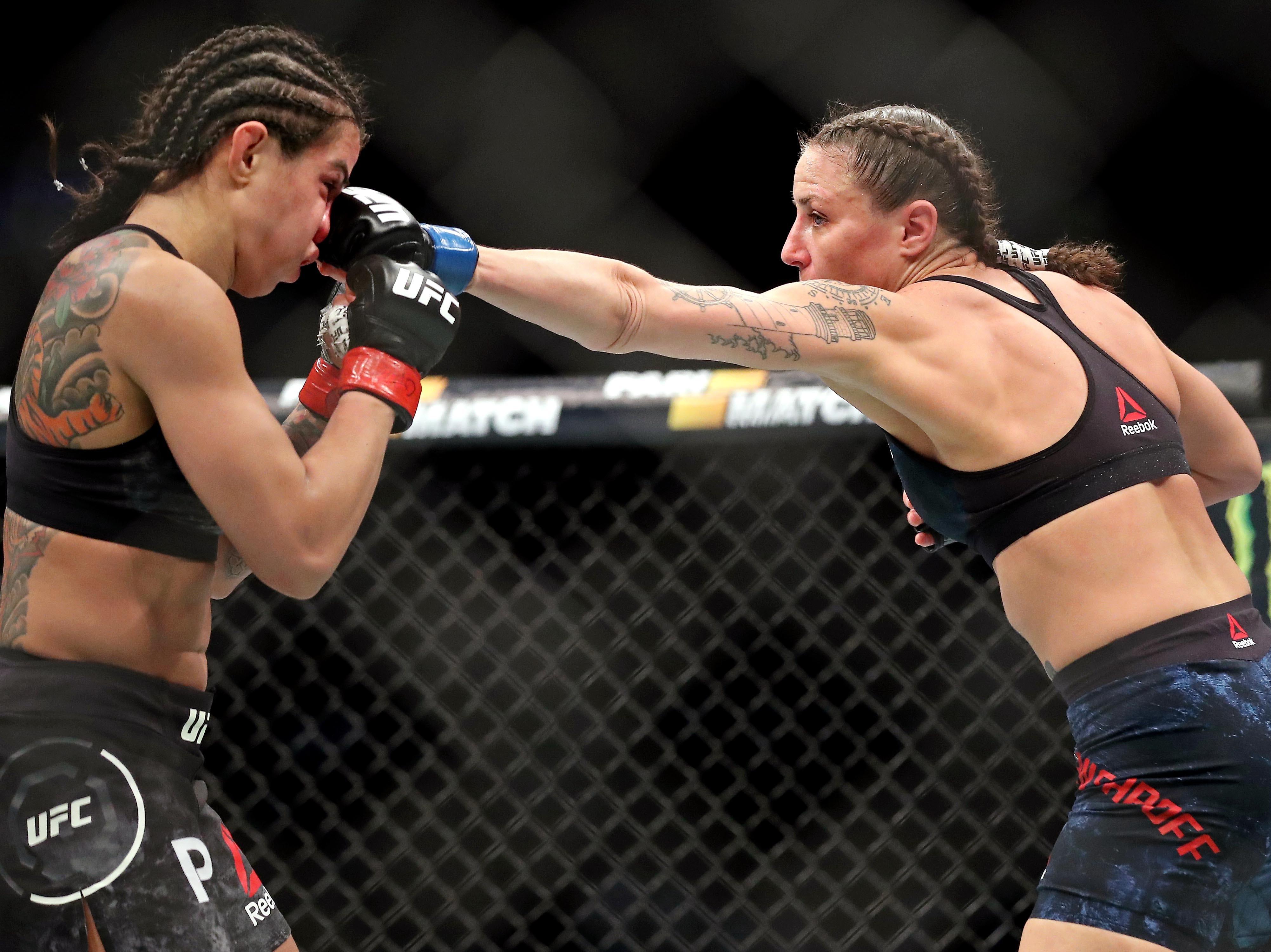Claudia Gadelha (red gloves) fights Nina Ansaroff (blue gloves) during UFC 231 at Scotiabank Arena.