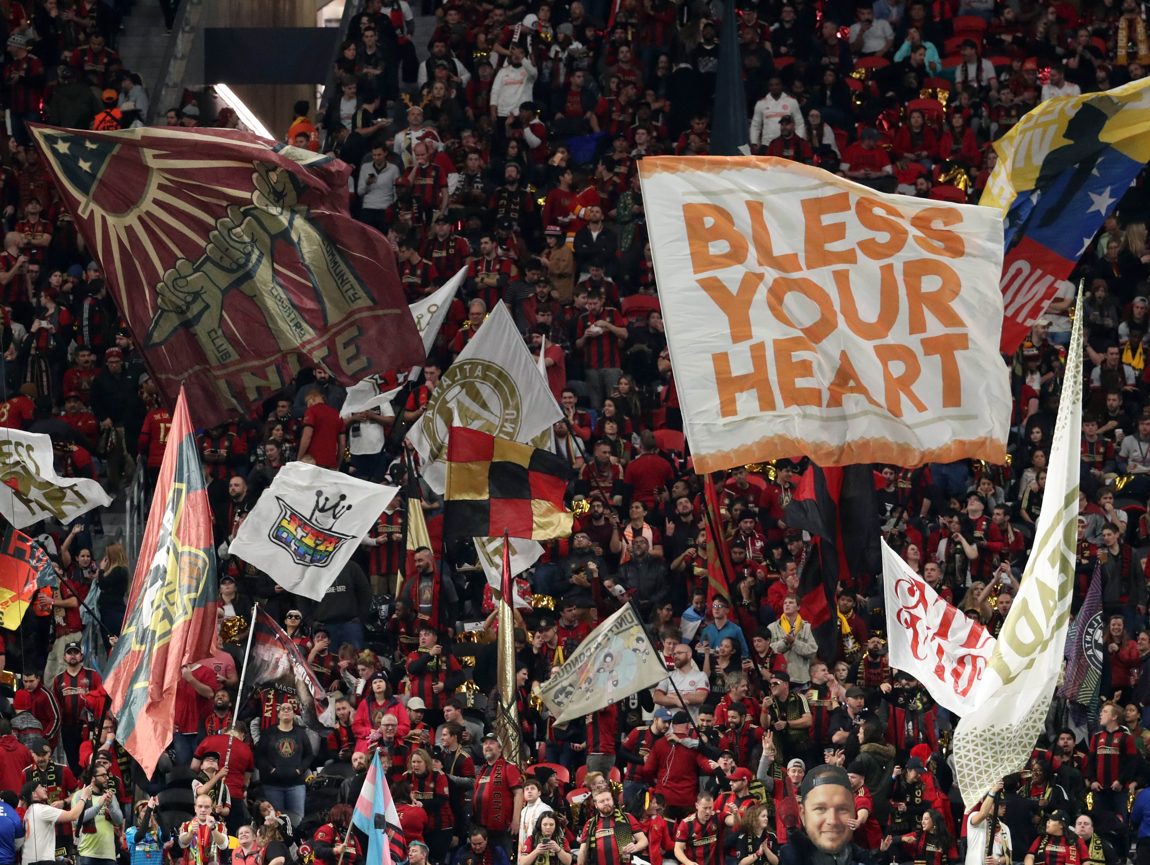 Atlanta United fans wave flags in the stands prior to the 2018 MLS Cup championship game.