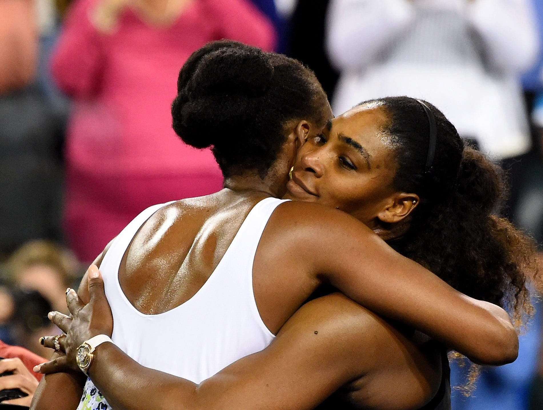 March 12: Venus Williams and Serena Williams hug after their third-round match in the BNP Paribas Open at the Indian Wells Tennis Garden.