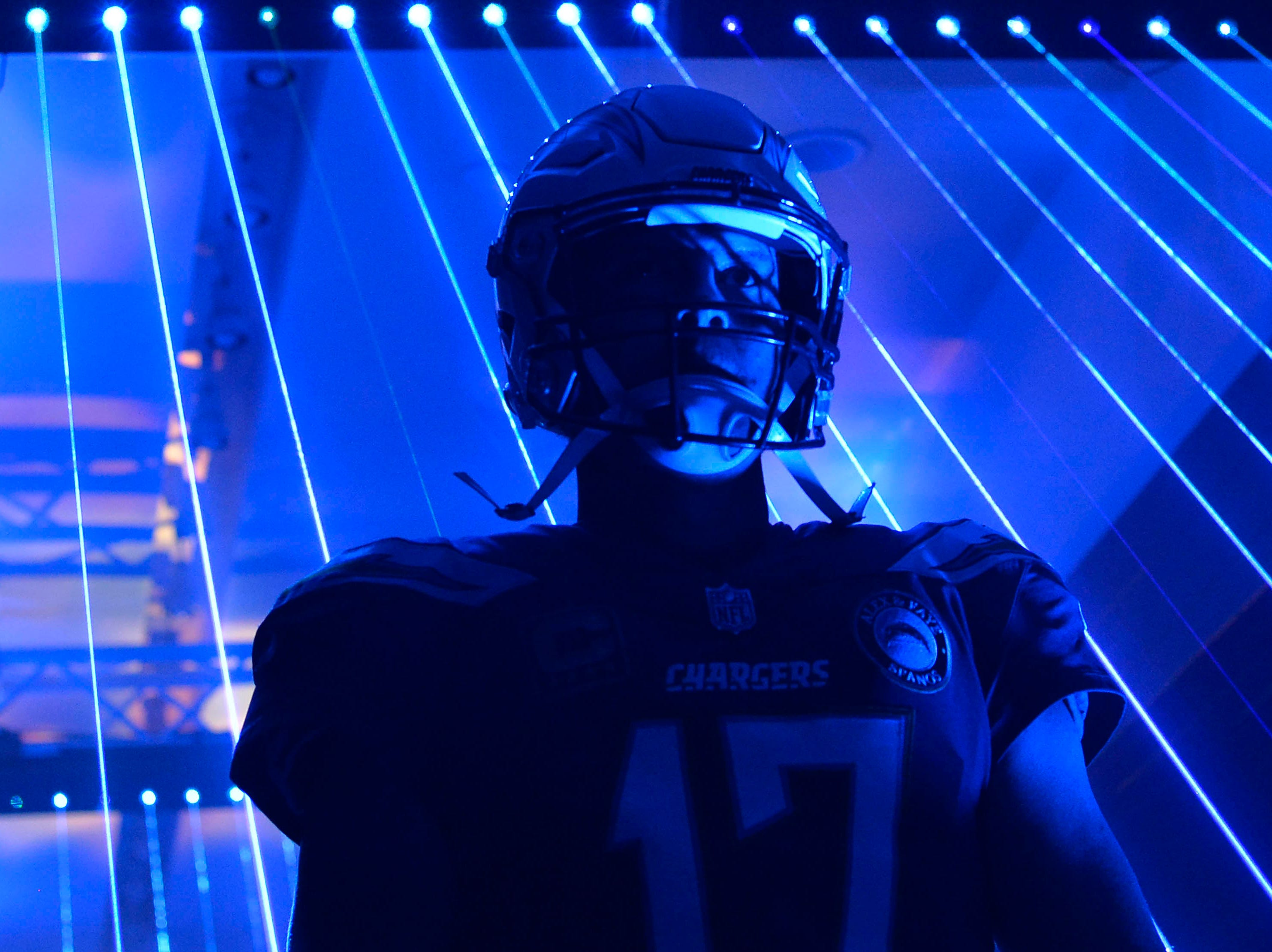 Chargers quarterback Philip Rivers walks to the field before the game against the Bengals.