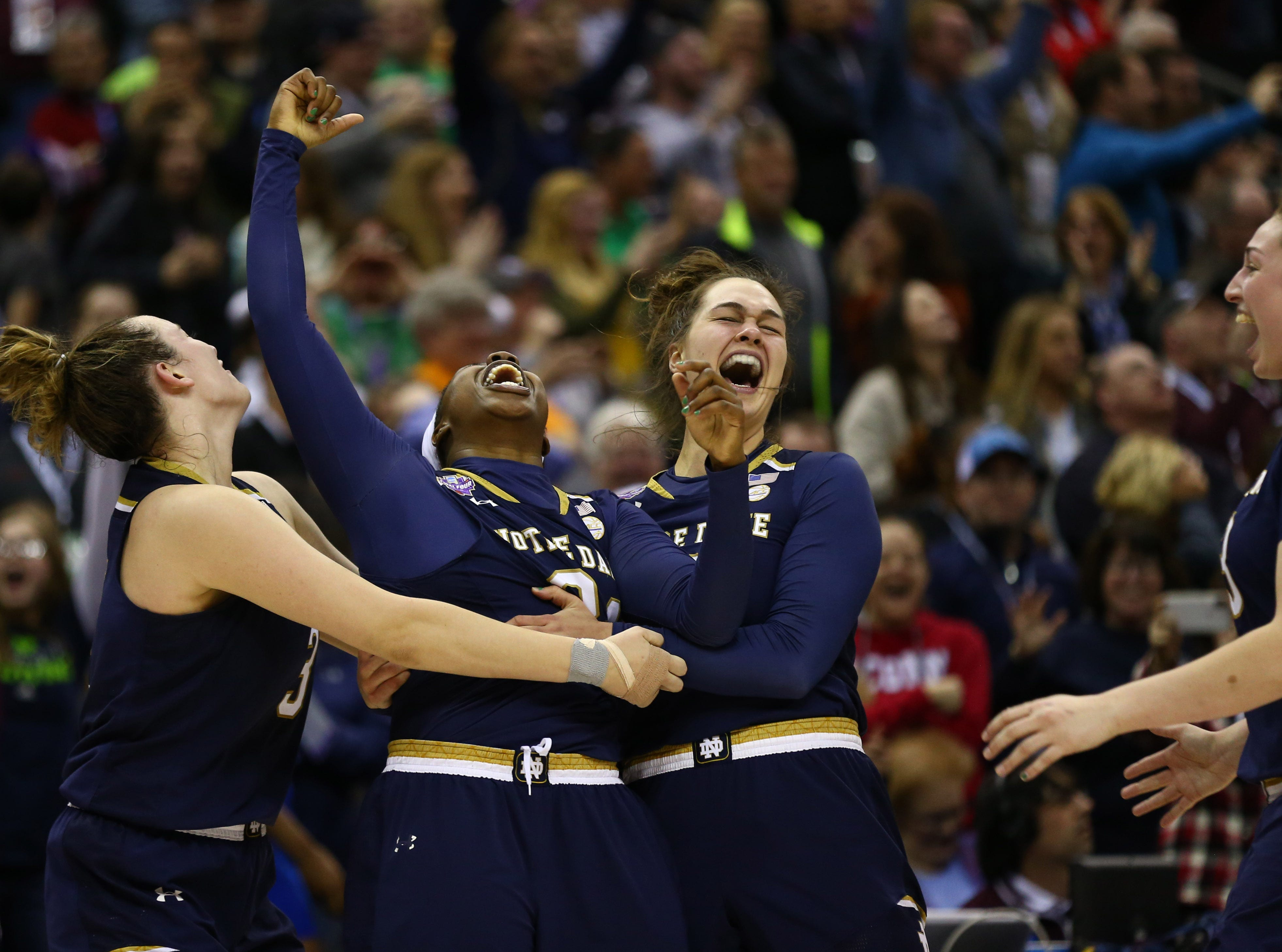 April 1: Notre Dame guard Arike Ogunbowale (middle) celebrates with teammates after making the game-winning basket against Mississippi State in the national title game.