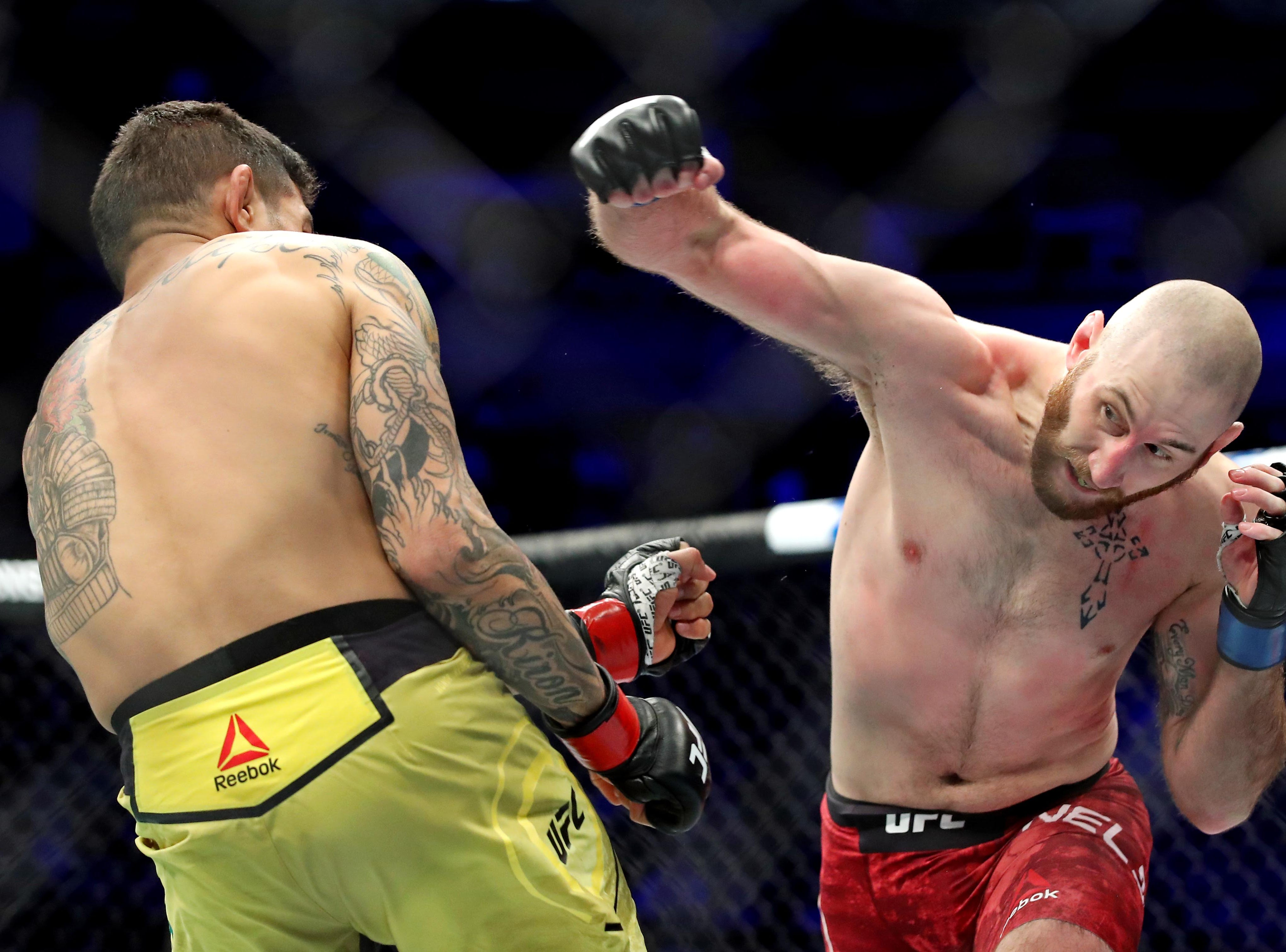 Diego Ferreira (red gloves) fights Kyle Nelson (blue gloves) during UFC 231 at Scotiabank Arena.