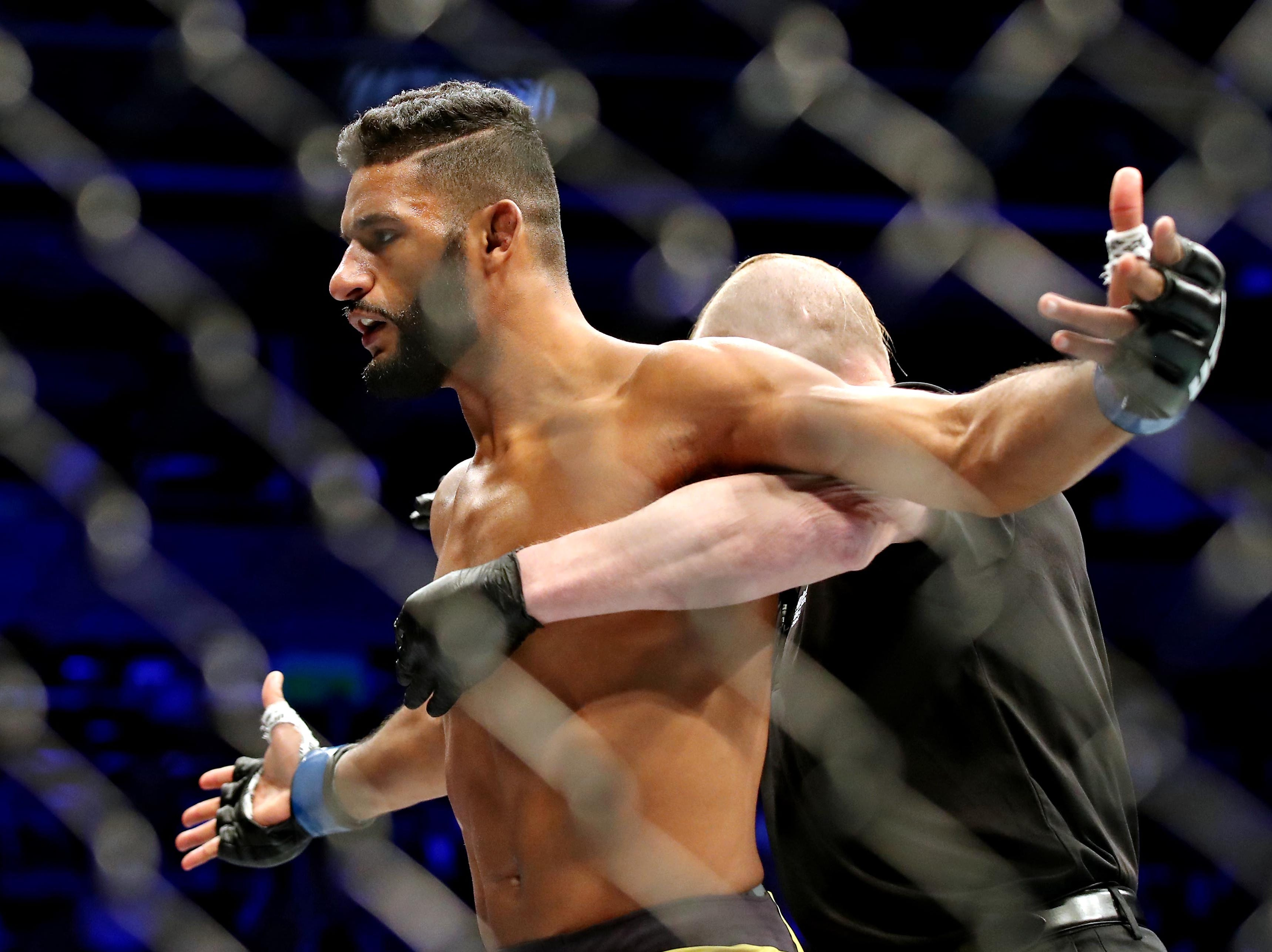 Dhiego Lima (blue gloves) celebrates beating Chad Laprise (red gloves) during UFC 231 at Scotiabank Arena.