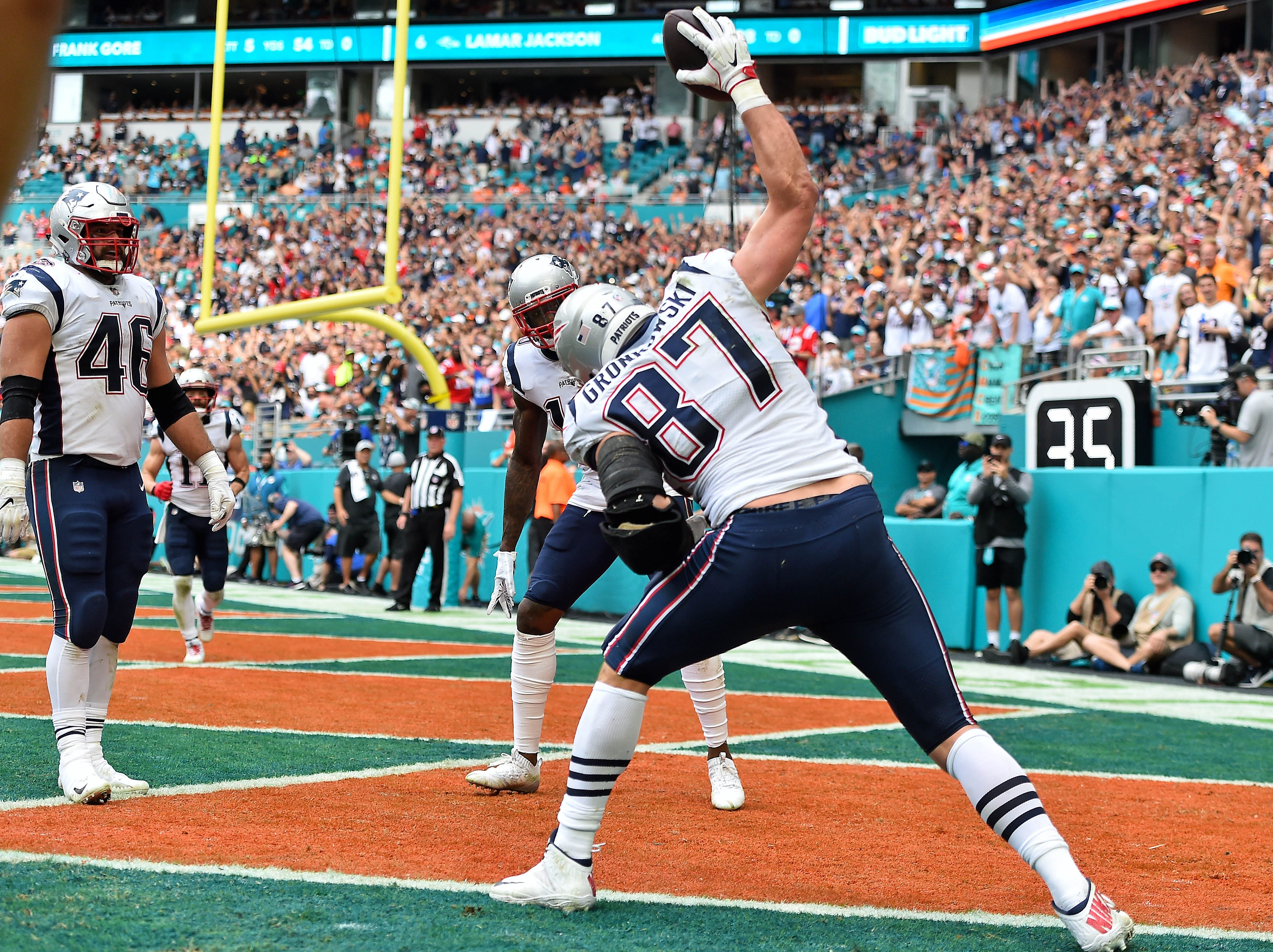 Patriots tight end Rob Gronkowski spikes the ball after a touchdown against the Dolphins.