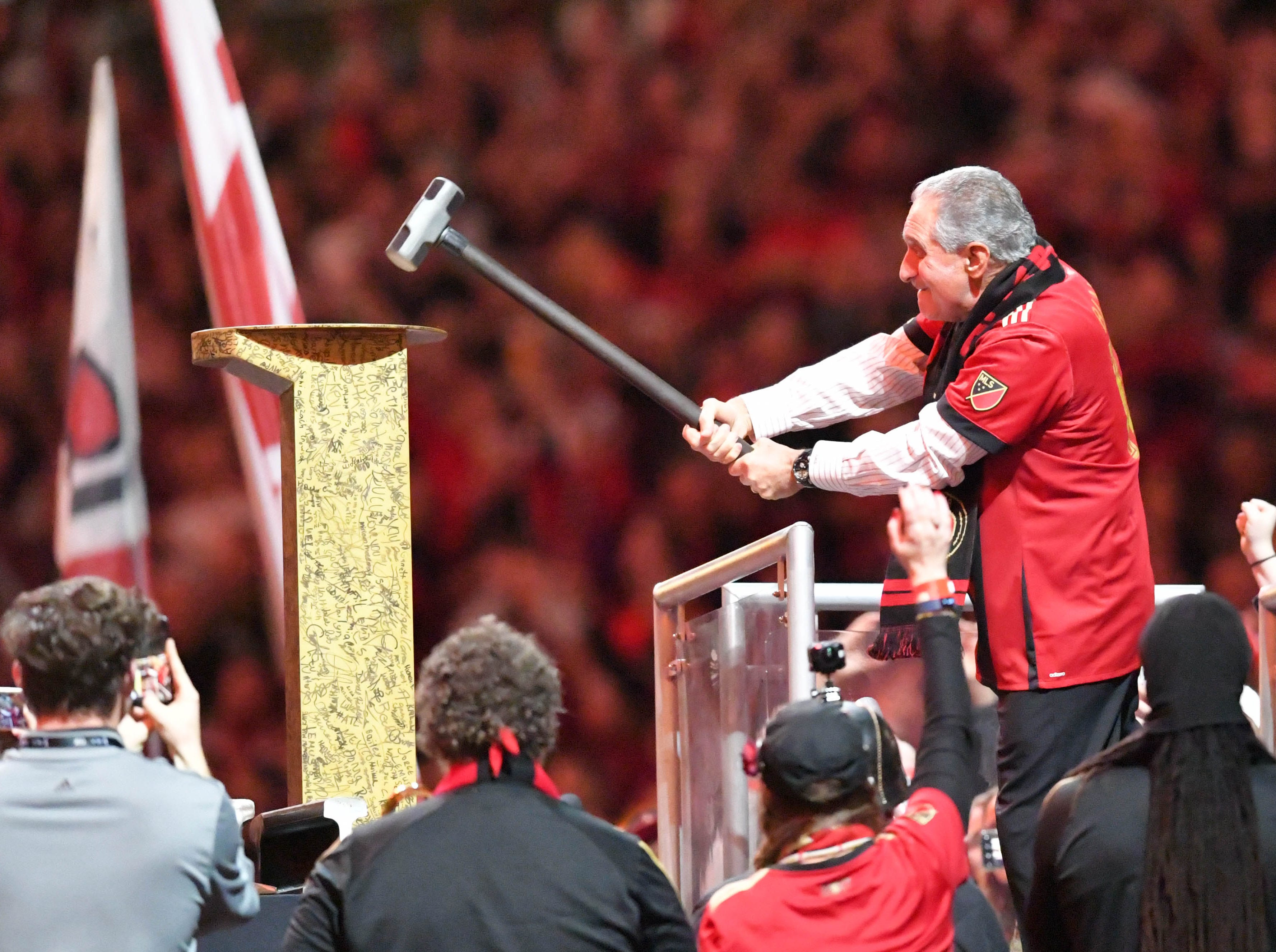 Atlanta United owner Arthur Blank hits the golden spike before the 2018 MLS Cup championship game against the Portland Timbers.