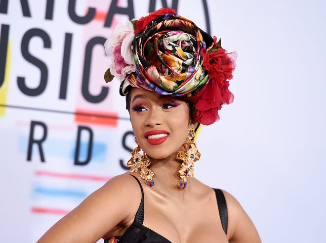 In this Oct. 9, 2018, file photo, Cardi B arrives at the American Music Awards, at the Microsoft Theater in Los Angeles.   Cardi B, Pharrell, Kanye West were among the celebrities who fanned out across Miami for a week of glamorous parties toasting the world's best artists during Art Basel.