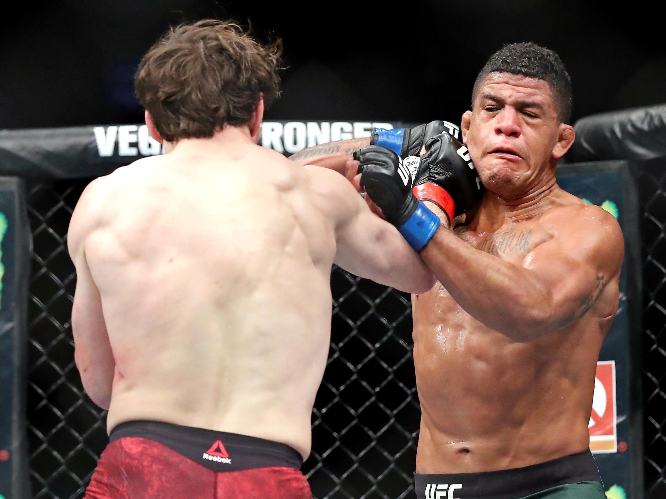 Olivier Aubin-Mercier (red gloves) fights Gilbert Burns (blue gloves) during UFC 231 at Scotiabank Arena.