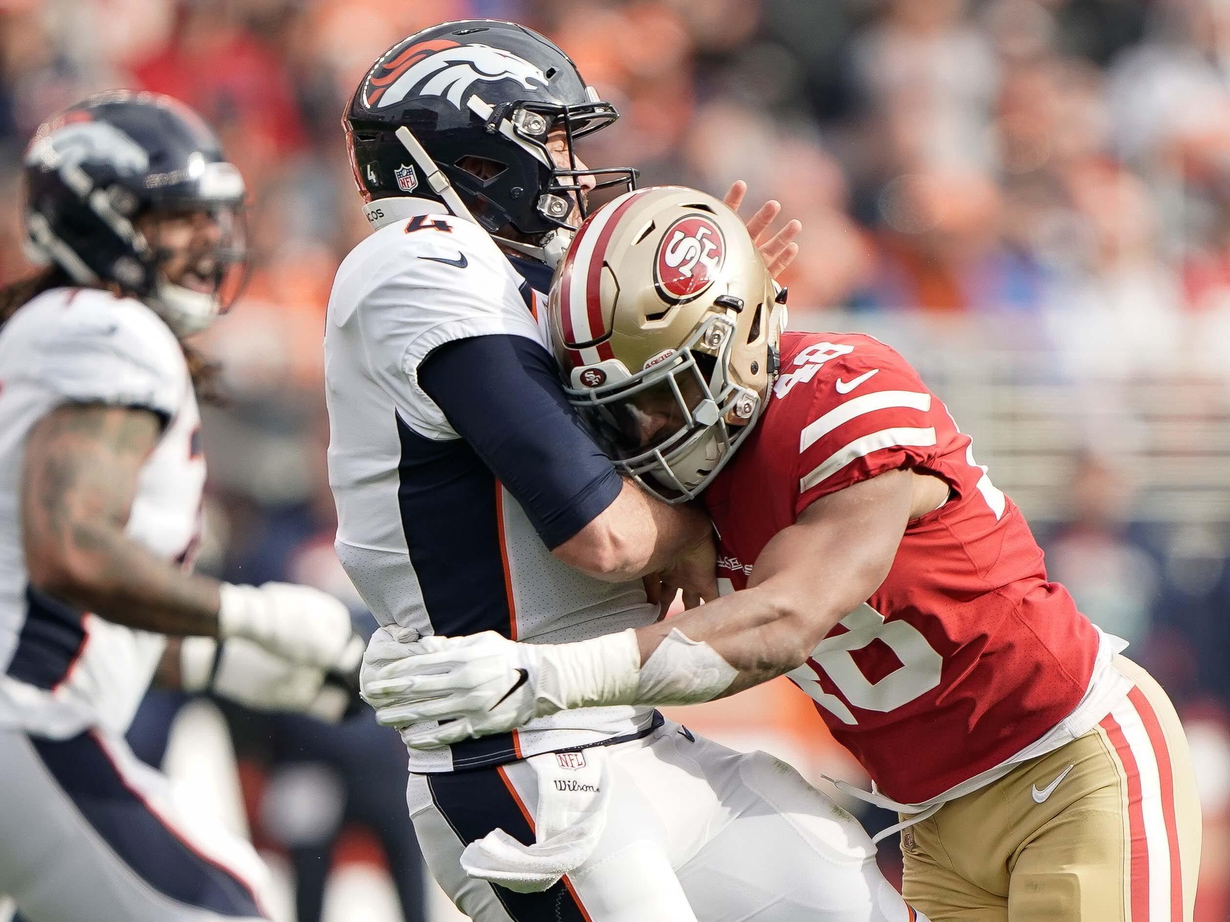 49ers linebacker Fred Warner hits Broncos quarterback Case Keenum.