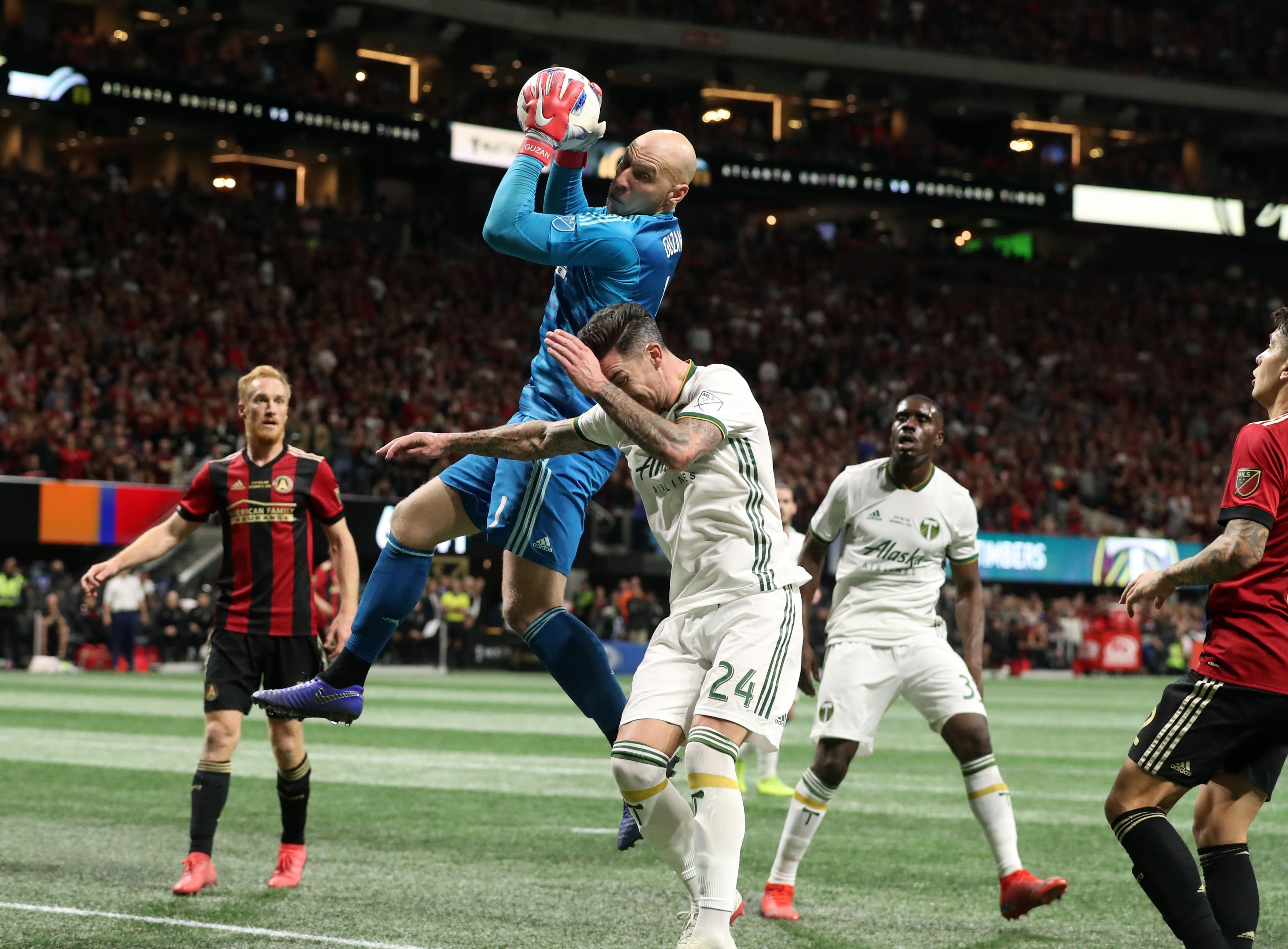 Atlanta United goalkeeper Brad Guzan (1) makes a save against Portland Timbers defender Liam Ridgewell (24) during the second half of the 2018 MLS Cup.