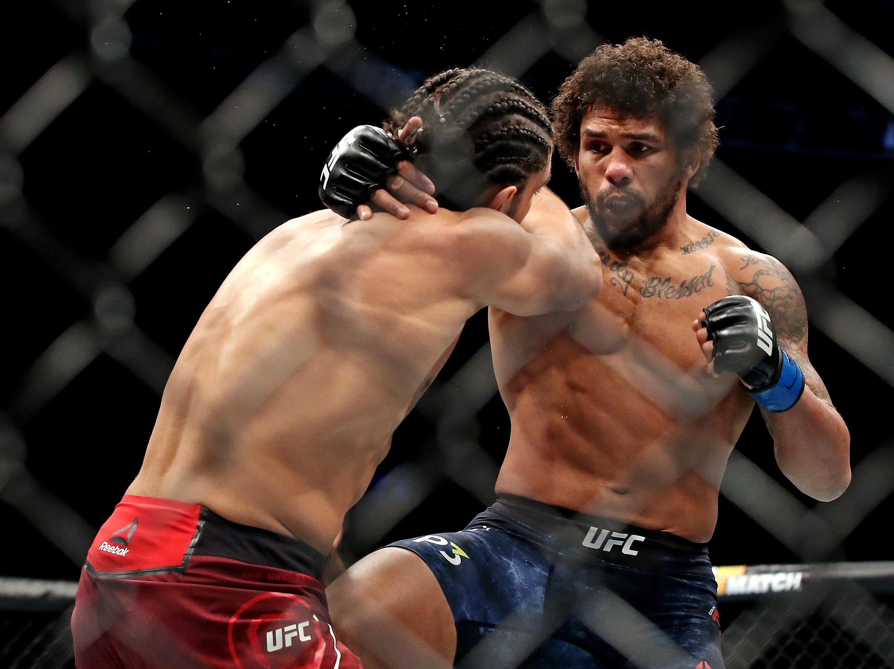 Elias Theodorou (red gloves) fights Eryk Anders (blue gloves) during UFC 231 at Scotiabank Arena.
