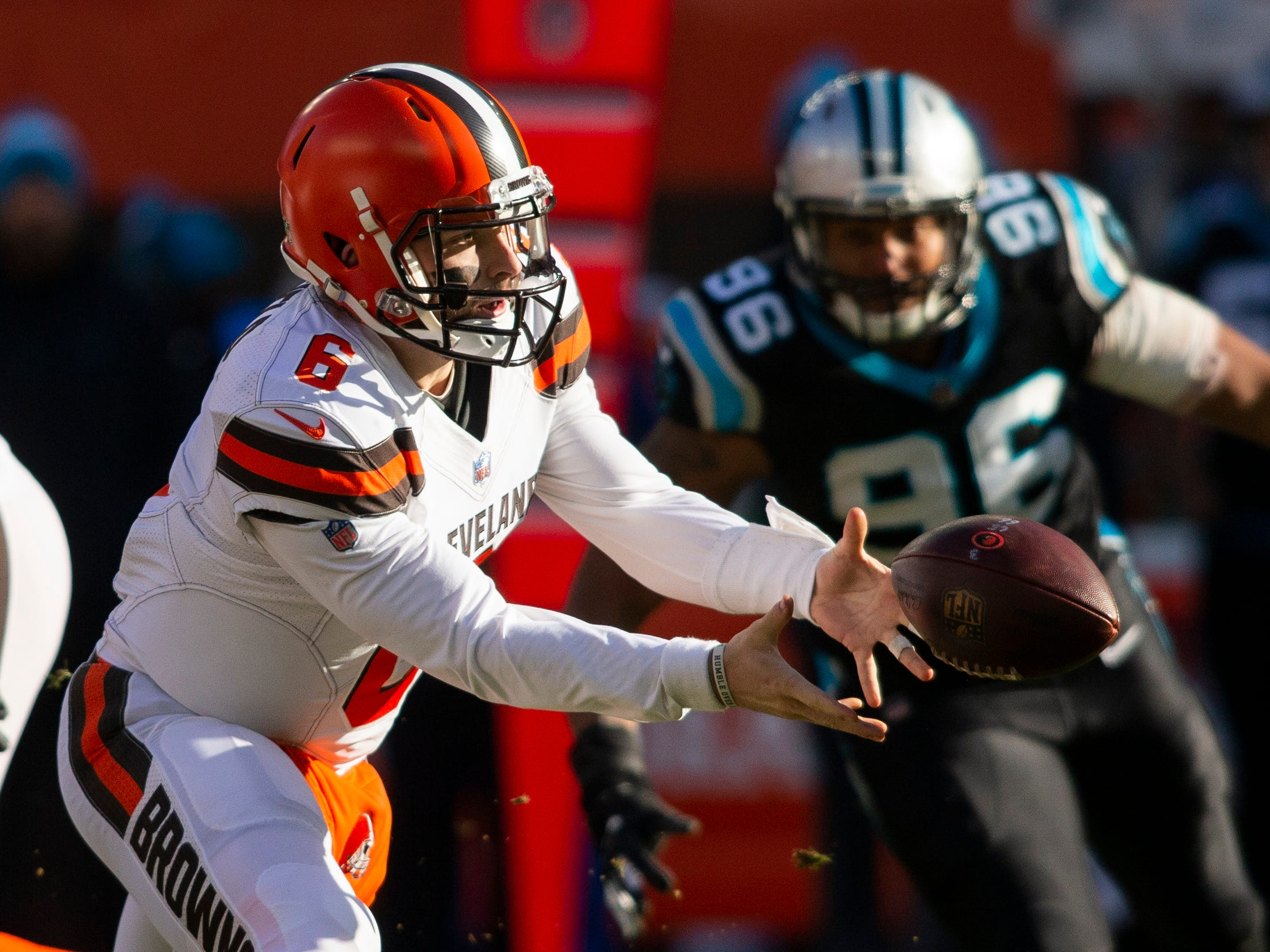 Browns quarterback Baker Mayfield tosses the ball against the Panthers.