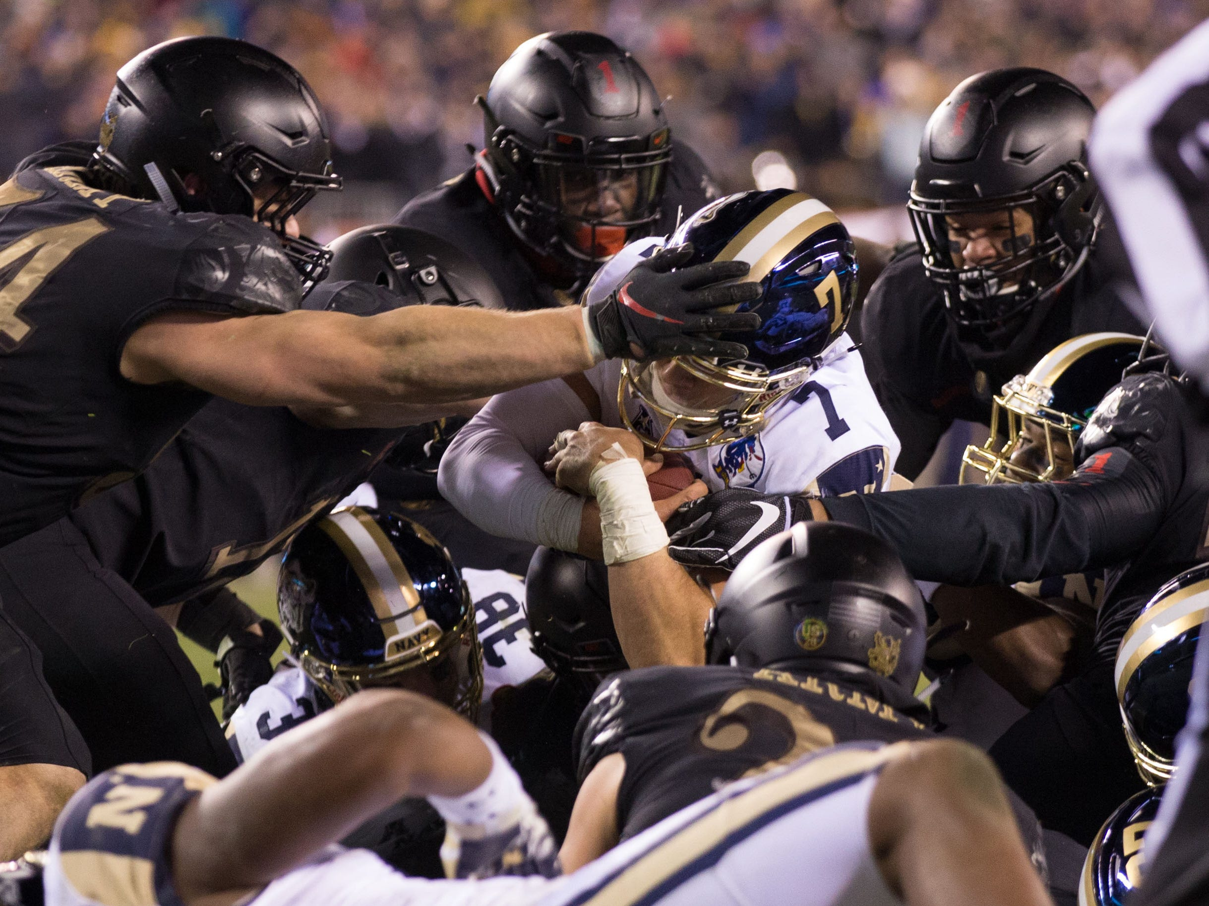 Navy Midshipmen quarterback Garret Lewis (7) scores a touchdown against the Army Black Knights during the fourth quarter at Lincoln Financial Field.