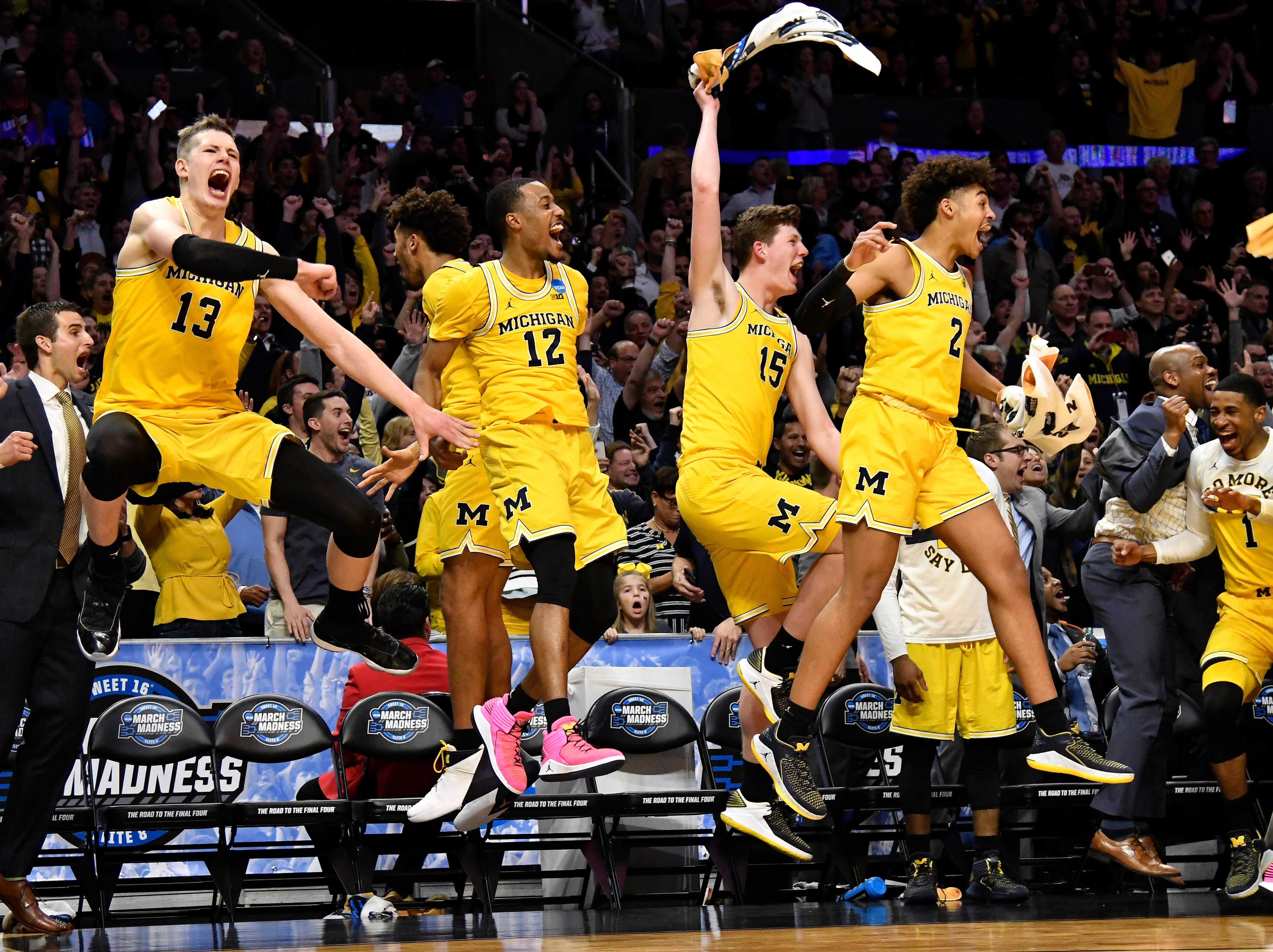 March 22: The Michigan Wolverines celebrate during their Sweet 16 win over the Texas A&M Aggies.