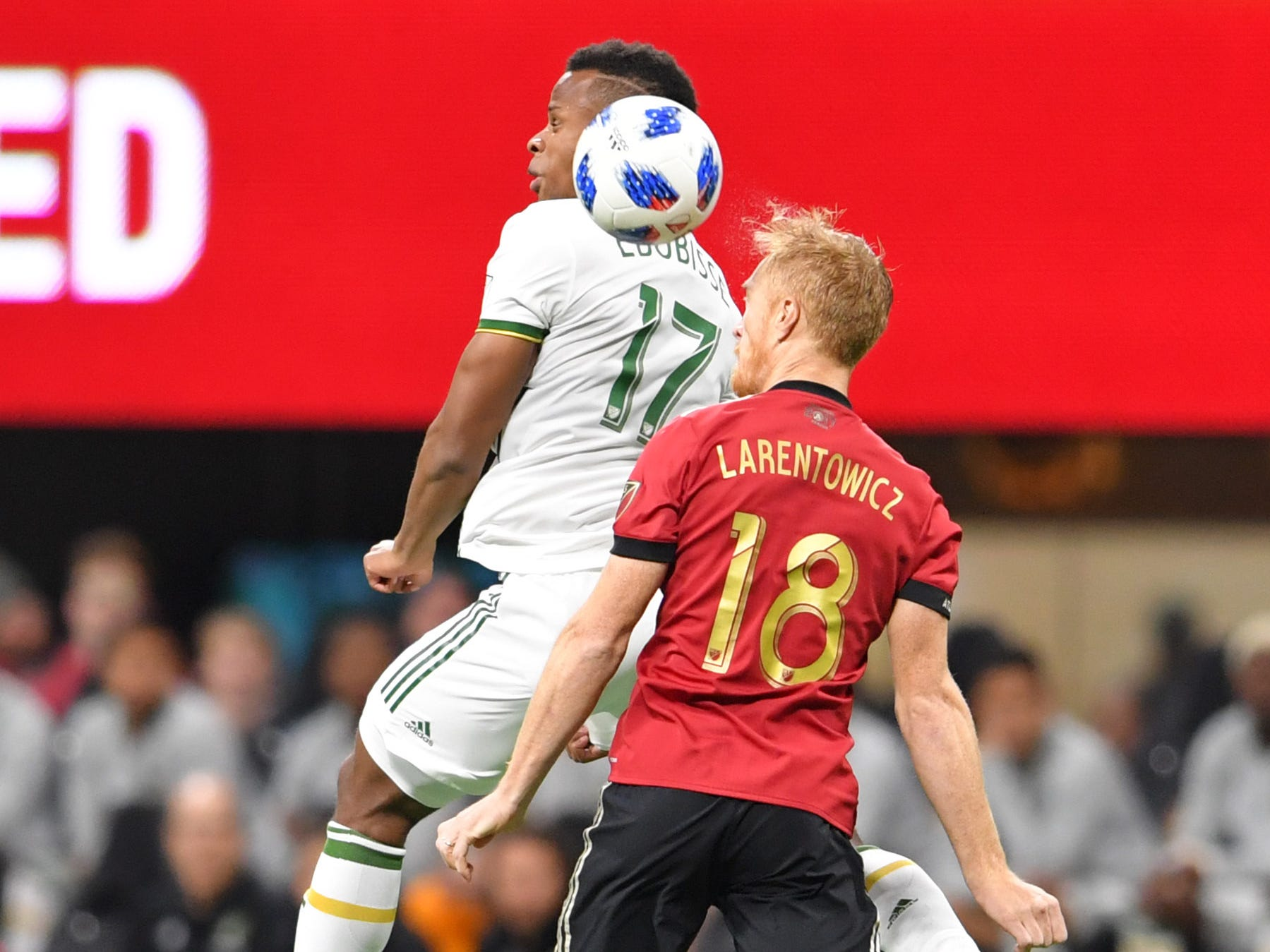 Portland Timbers forward Jeremy Ebobisse (17) battles for a header with Atlanta United defender Jeff Larentowicz during the first half of the MLS Cup.