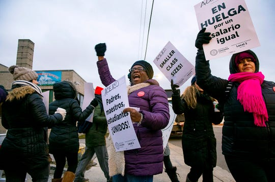 Educators with Acero charter schools strike outside the Veterans Memorial Charter School Campus, Tuesday, Dec. 4, 2018, in Chicago.