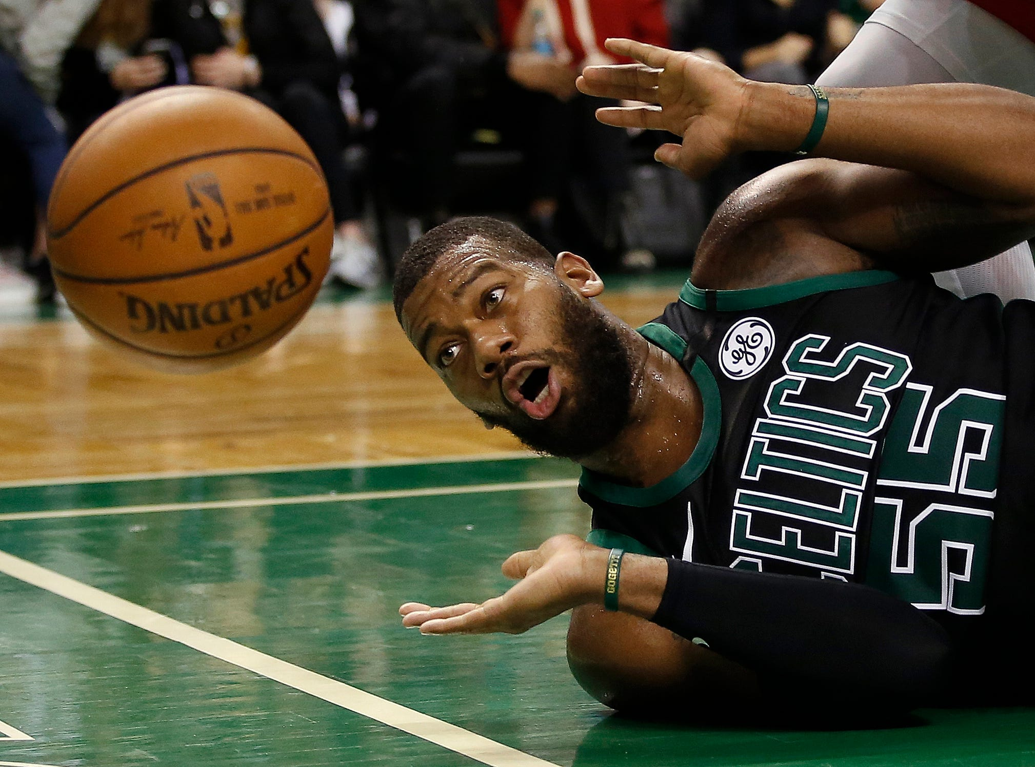 March 31: Boston Celtics center Greg Monroe (55) eyes a loose ball as it goes out of bounds during the second half of Boston's win over the Toronto Raptors at TD Garden.