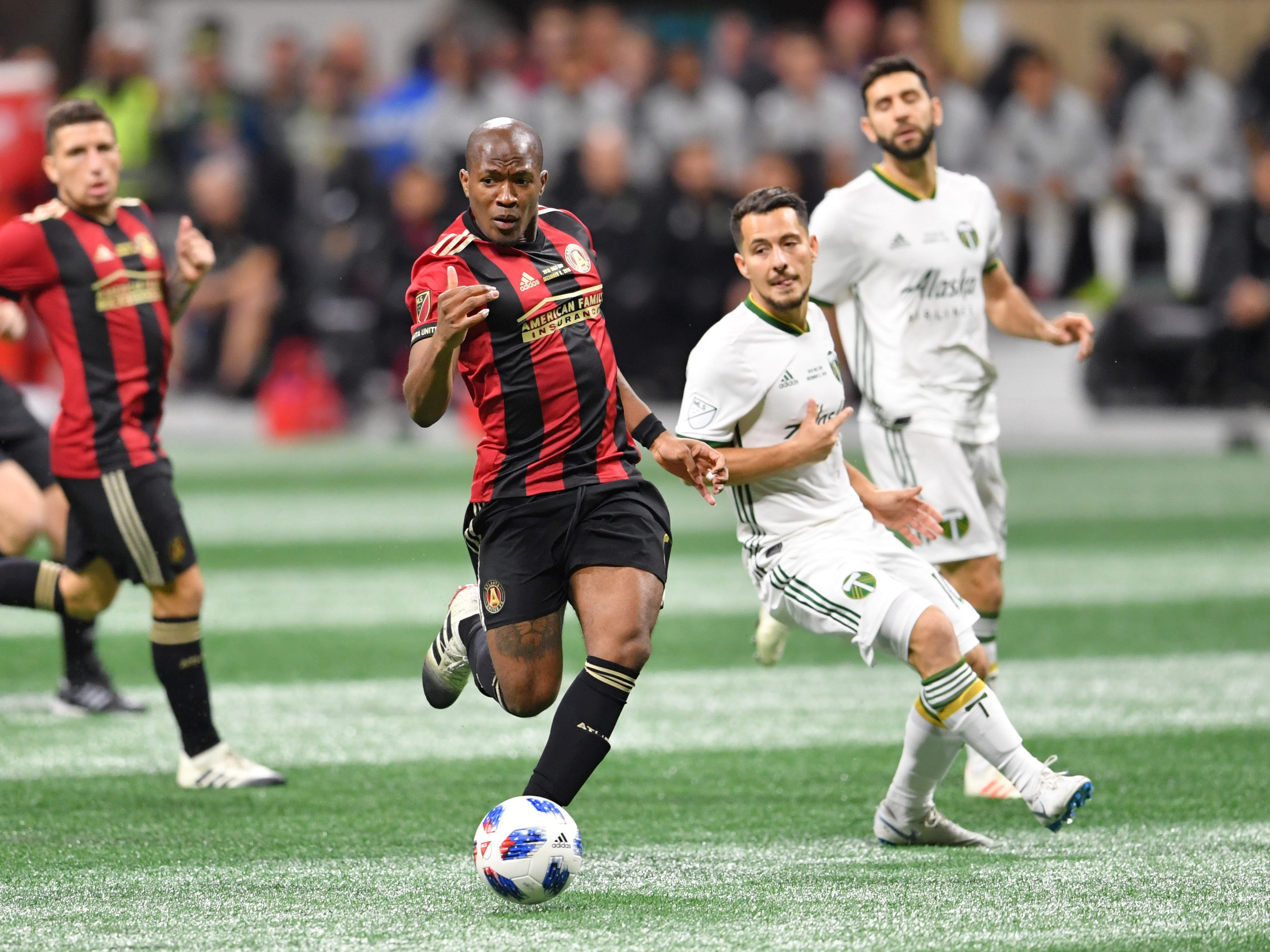 Atlanta United midfielder Darlington Nagbe, left, gathers the ball during the first half of the 2018 MLS Cup championship game against the Portland Timbers.