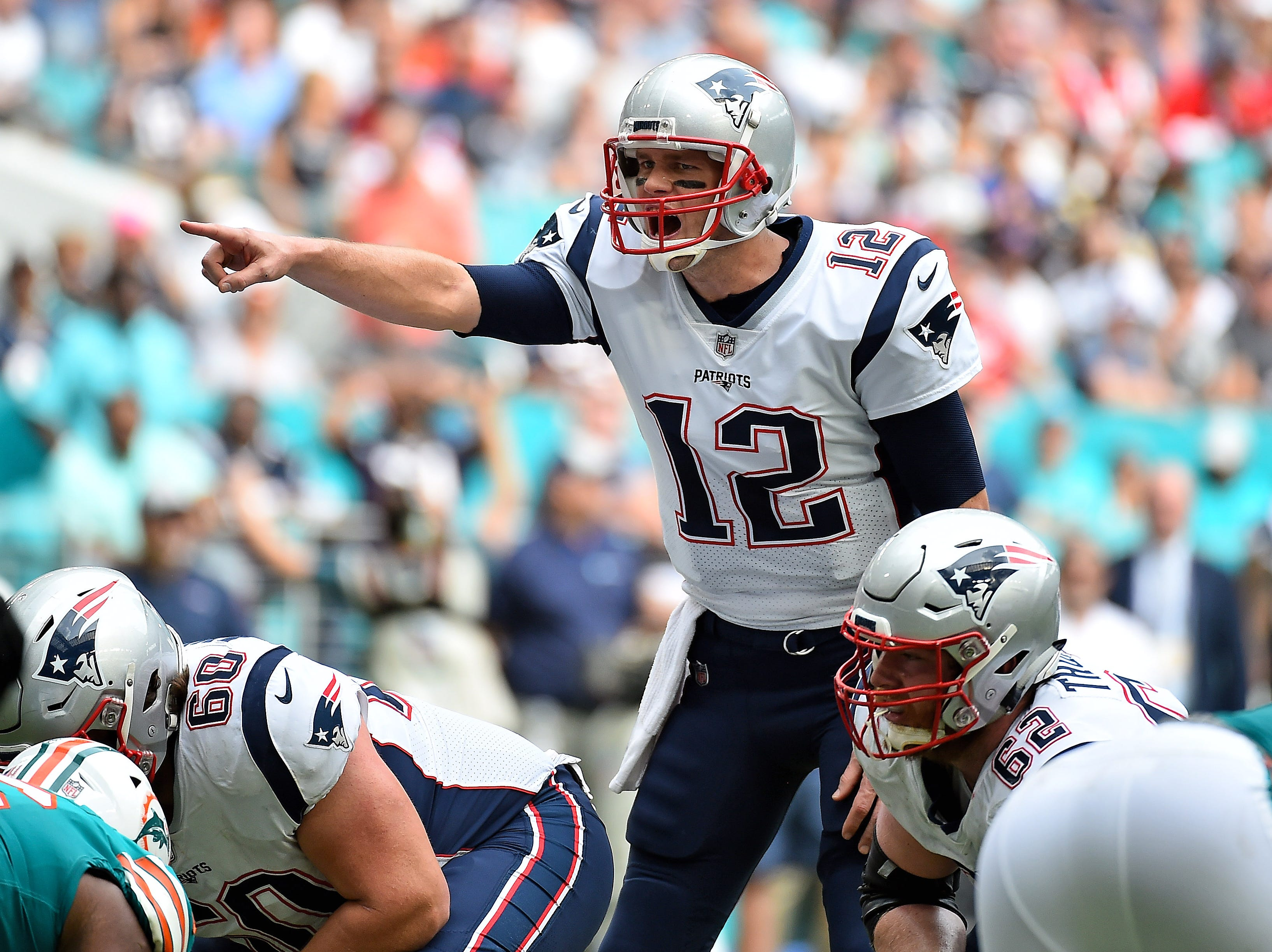 Patriots quarterback Tom Brady signals at the line of scrimmage against the Dolphins.