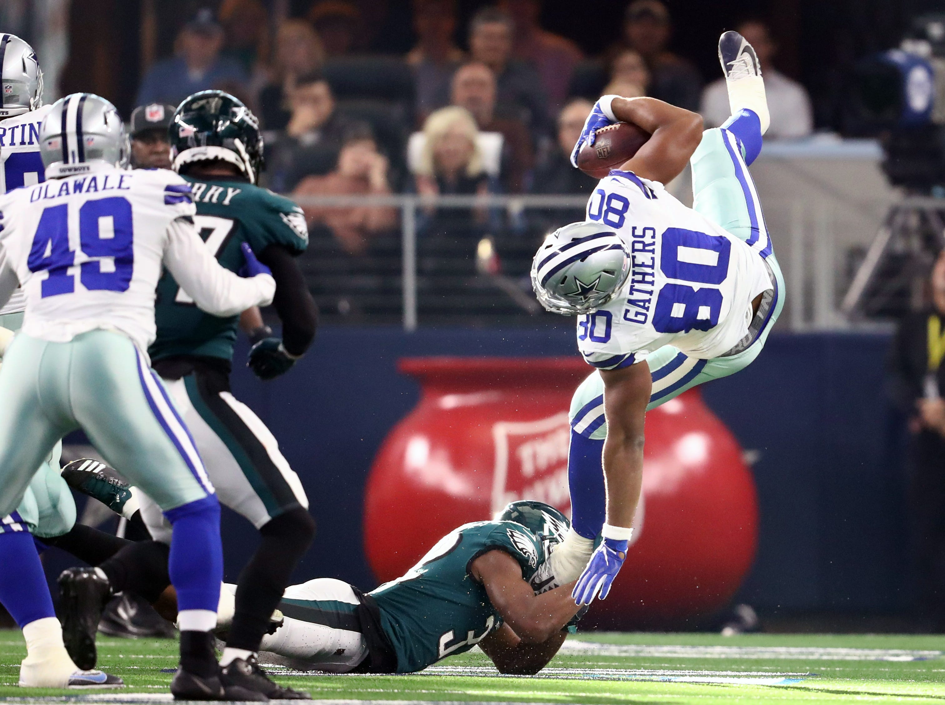 Cowboys tight end Rico Gathers  is upended in the first quarter against the Eagles.