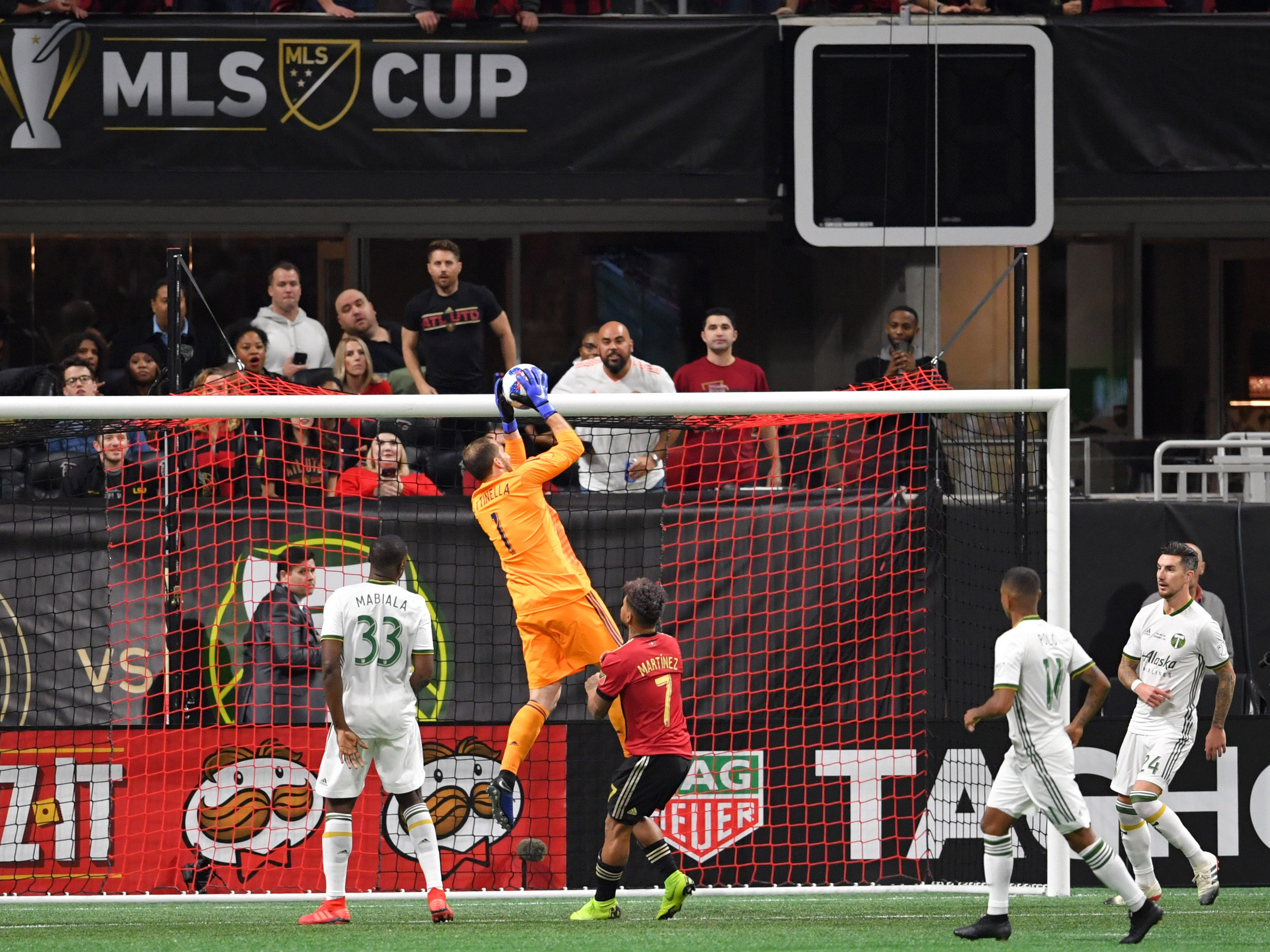 Portland Timbers goalkeeper Jeff Attinella makes a save against Atlanta United during the first half in the 2018 MLS Cup at Mercedes-Benz Stadium.