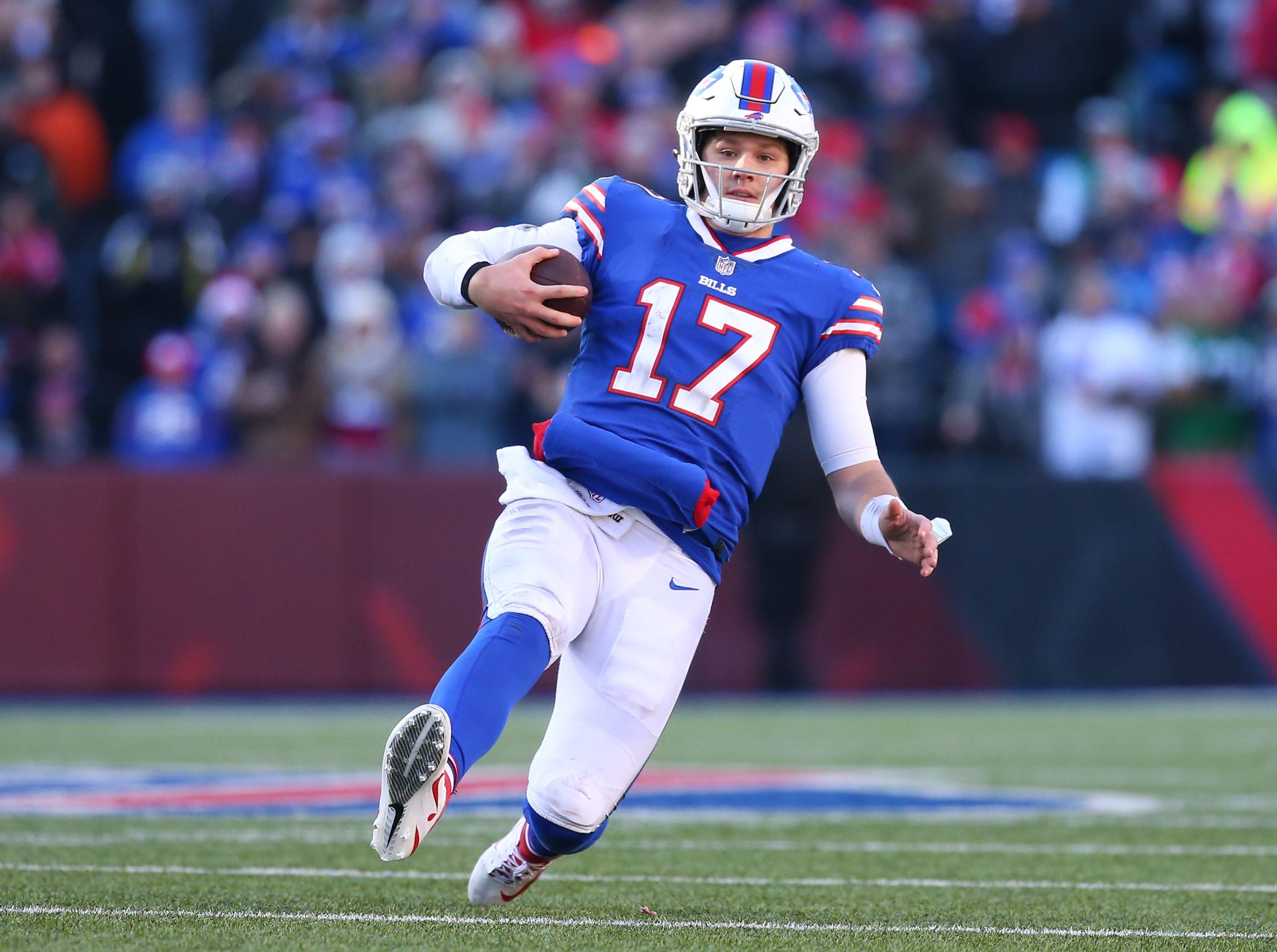 Bills quarterback Josh Allen slides following a run against the Jets.