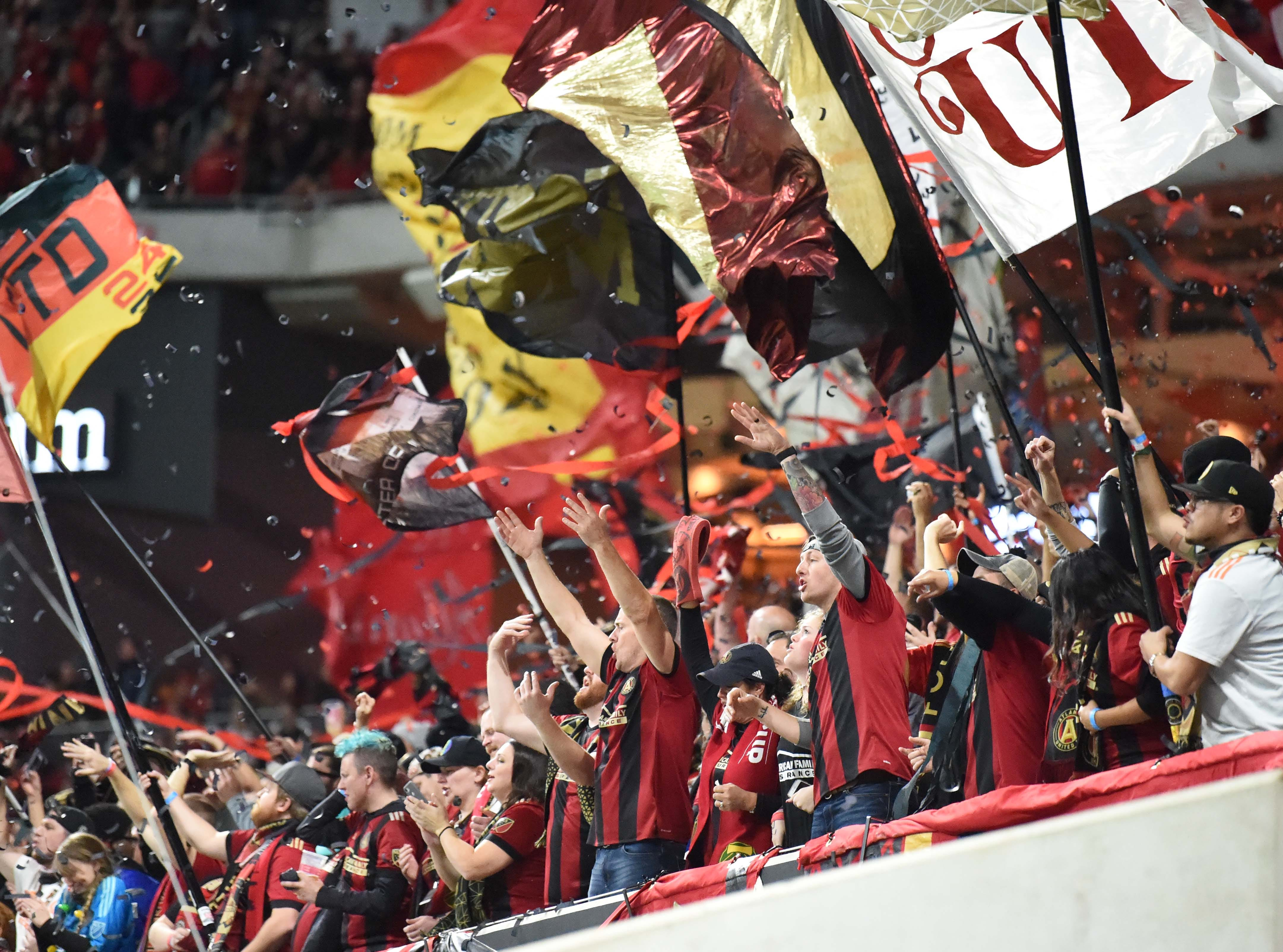 Atlanta United fans celebrate at Mercedes-Benz Stadium after the team wins its first MLS Cup.