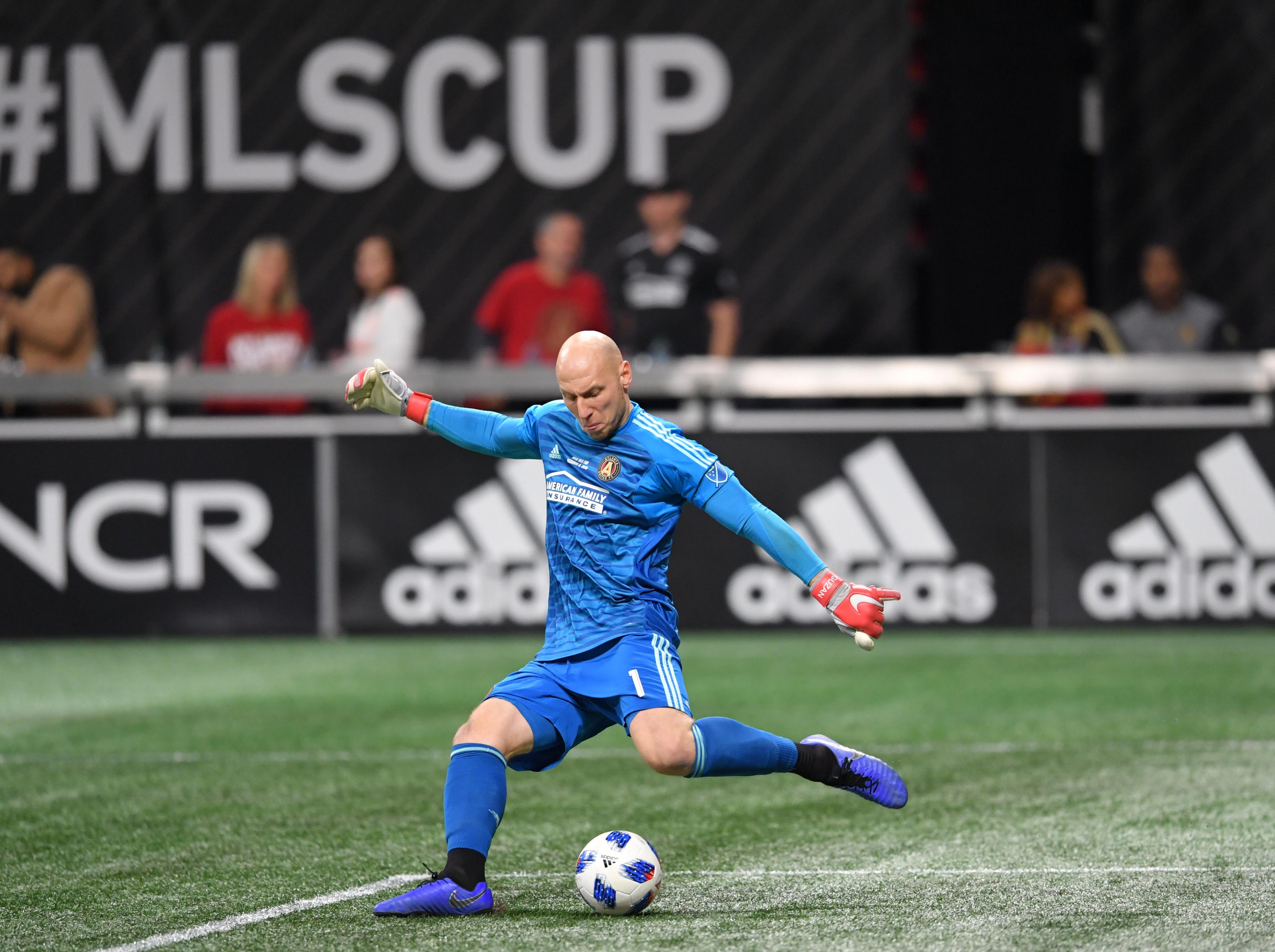 Atlanta United goalkeeper Brad Guzan boots a goal kick against the Portland Timbers in the first half in the 2018 MLS Cup at Mercedes-Benz Stadium.