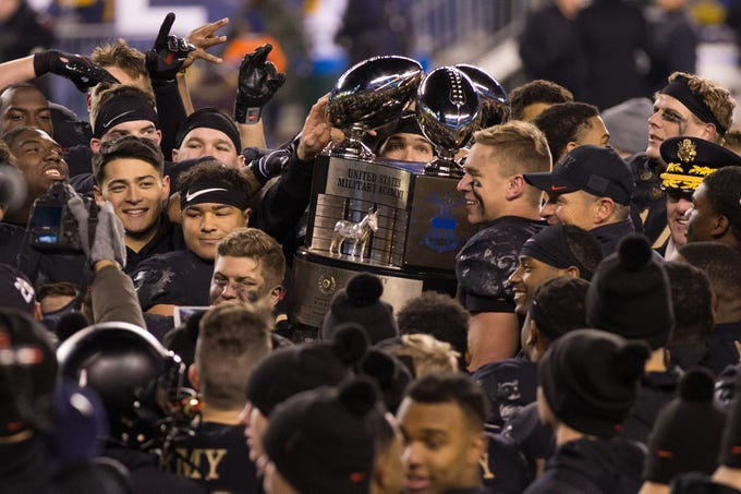 The Army Black Knights raise the Commander-In-Chief's Trophy after a victory against the Navy Midshipmen at Lincoln Financial Field.