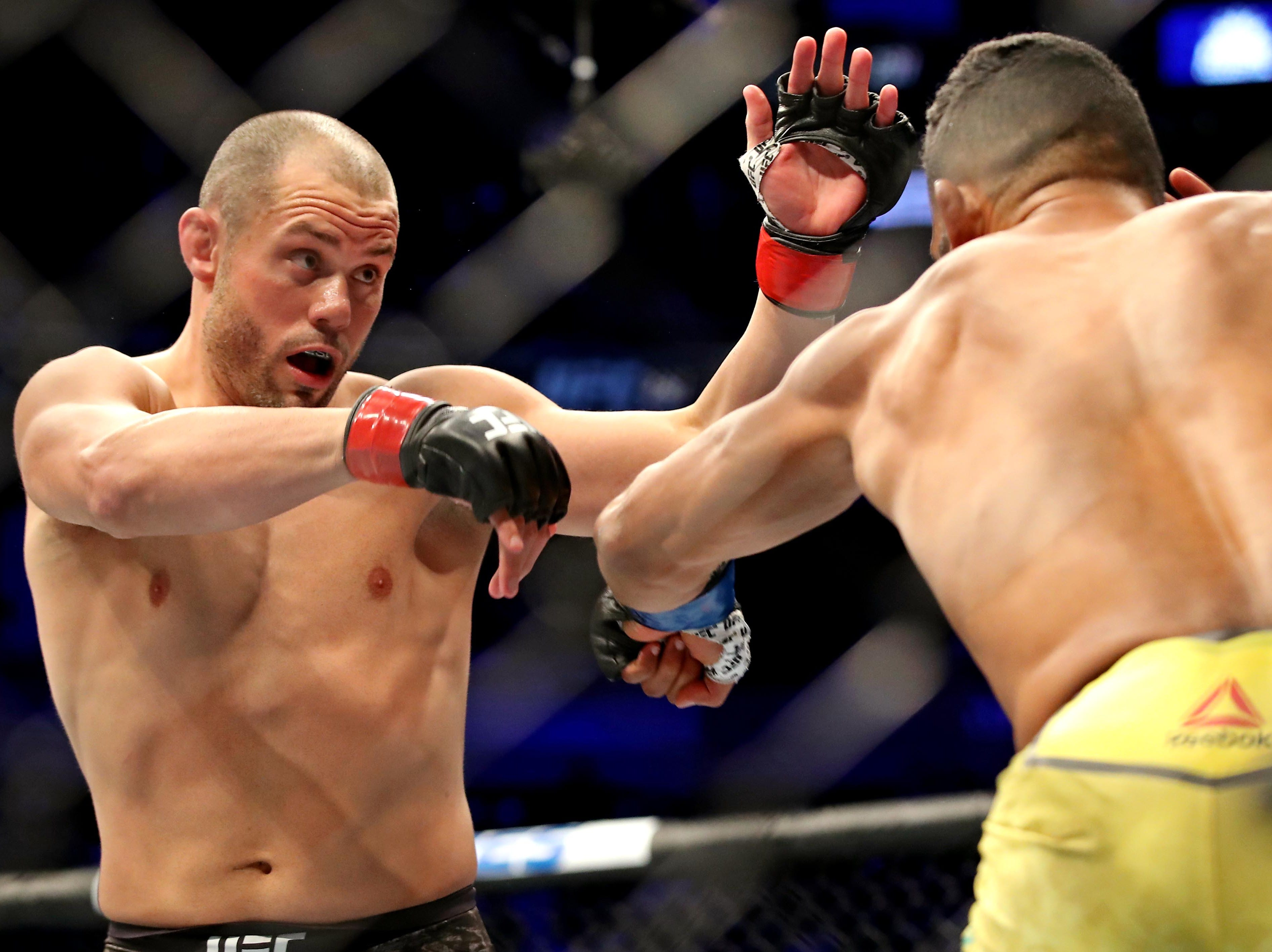 Chad Laprise (red gloves) fights Dhiego Lima (blue gloves) during UFC 231 at Scotiabank Arena.