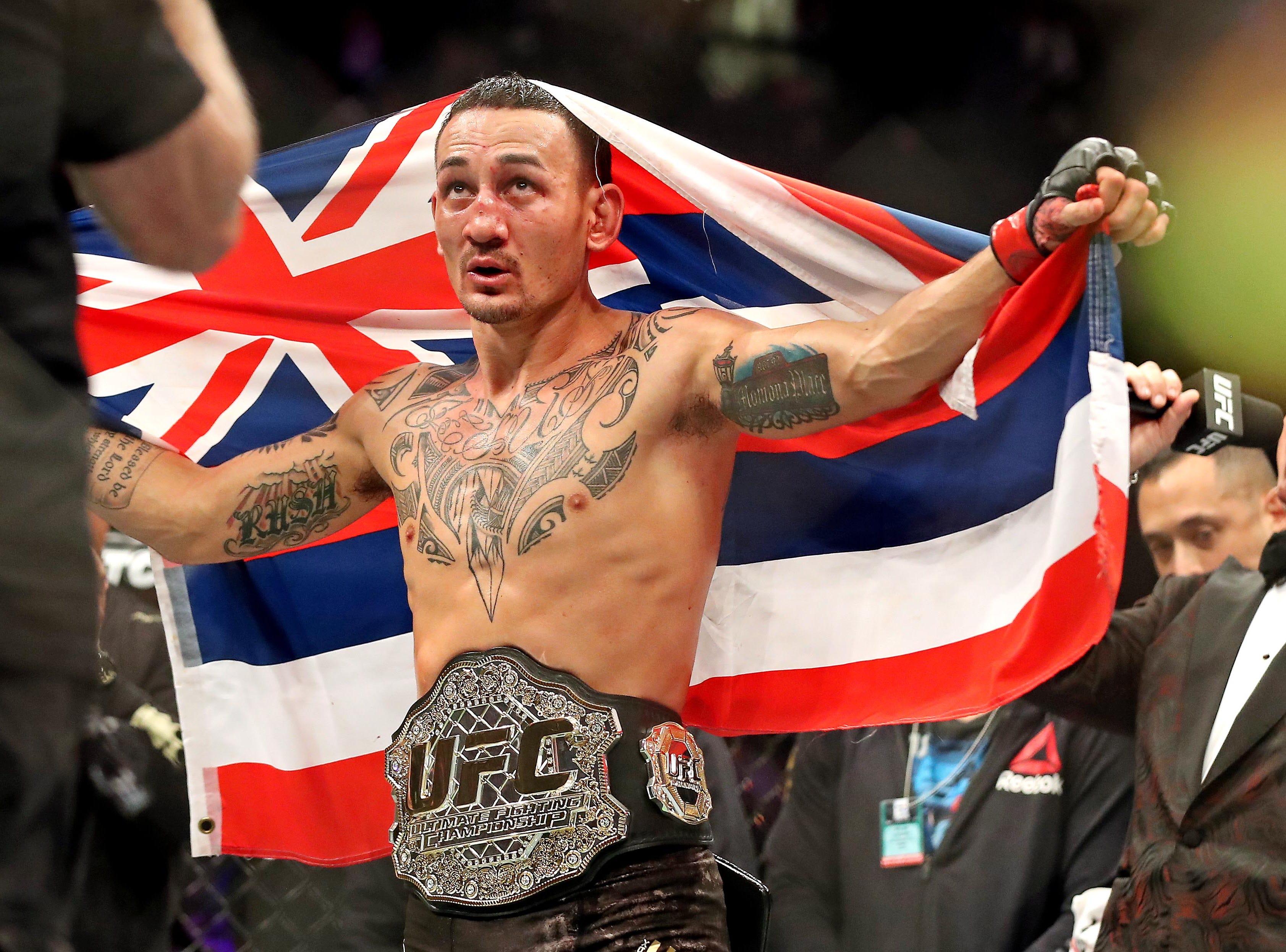 Max Holloway celebrates after beating Brian Ortega during UFC 231 at Scotiabank Arena.