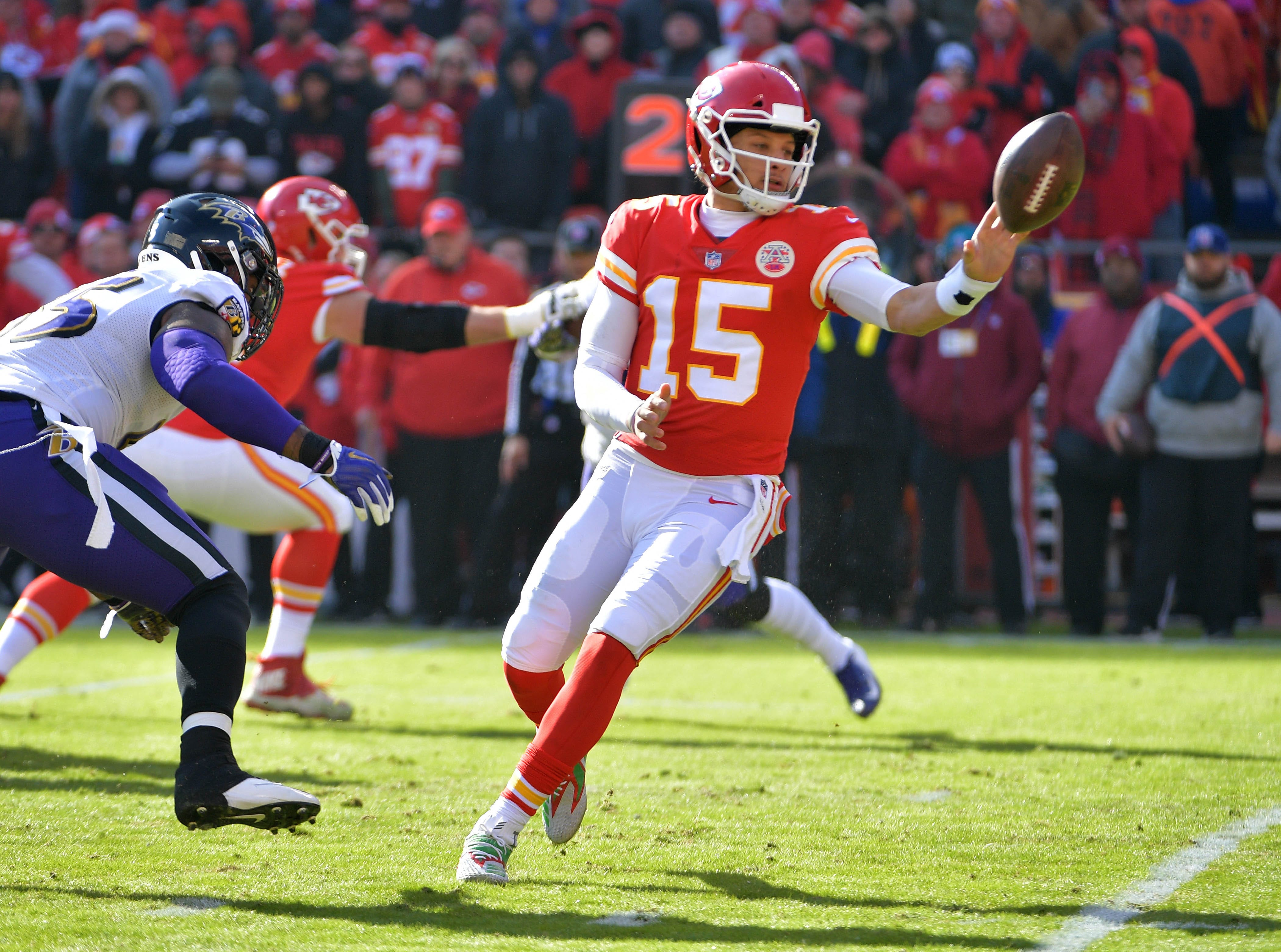 Chiefs quarterback Patrick Mahomes laterals the ball during the first half against the Ravens.