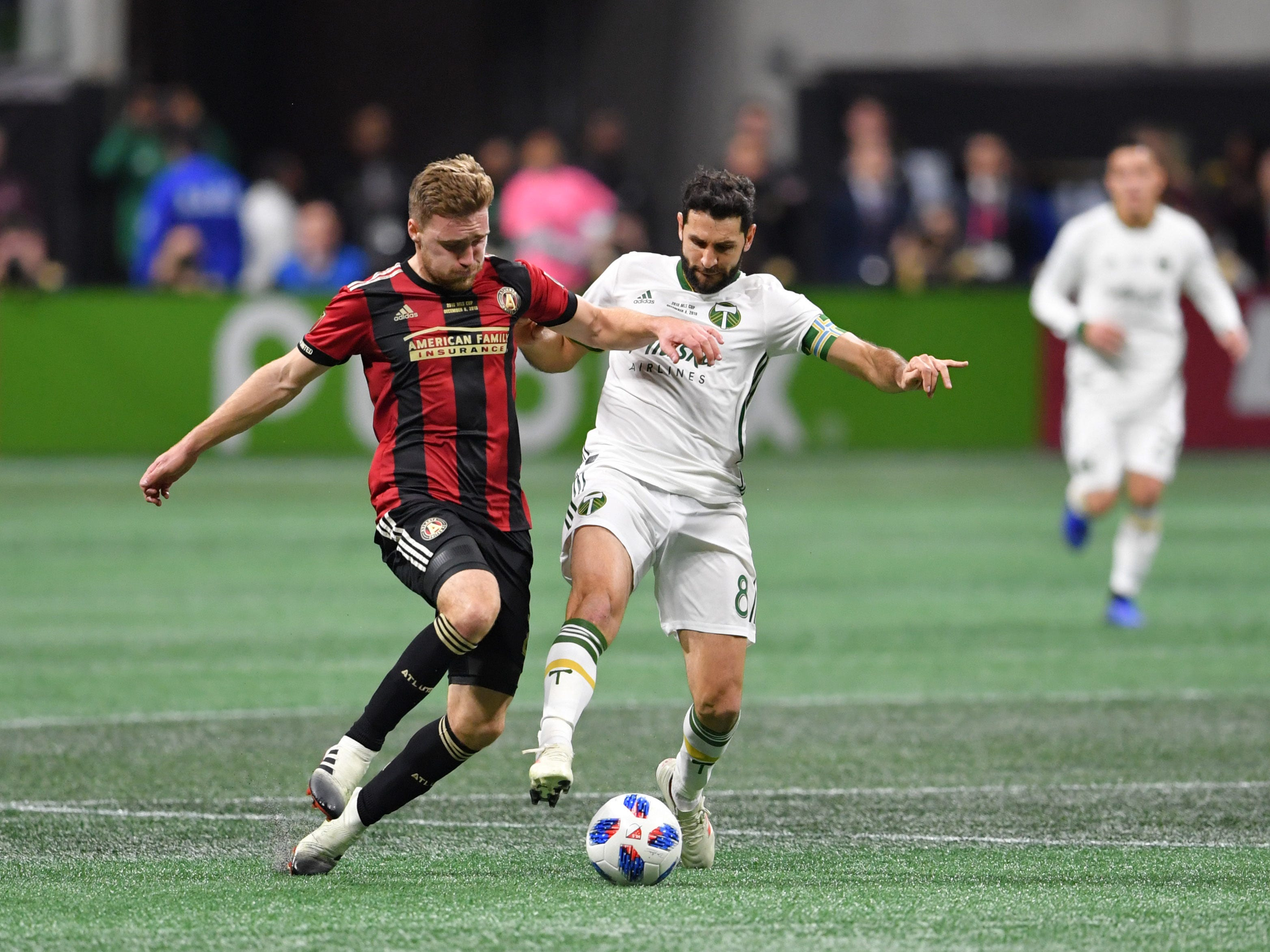 Portland Timbers midfielder Diego Valeri (8) battles for the ball with Atlanta United defender Greg Garza (4) during the first half in the 2018 MLS Cup.