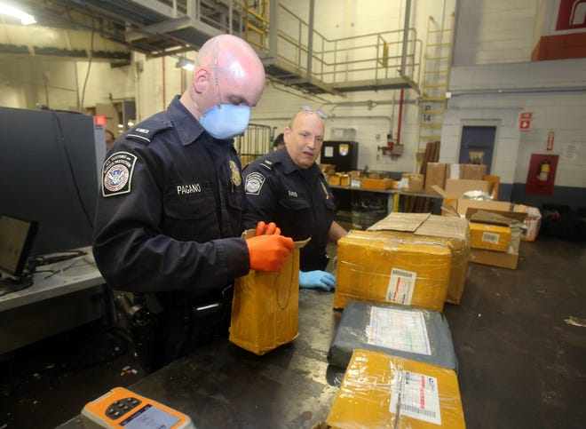Customs officers open packages suspected of containing fentanyl or other illegal narcotics at the JFK airport.