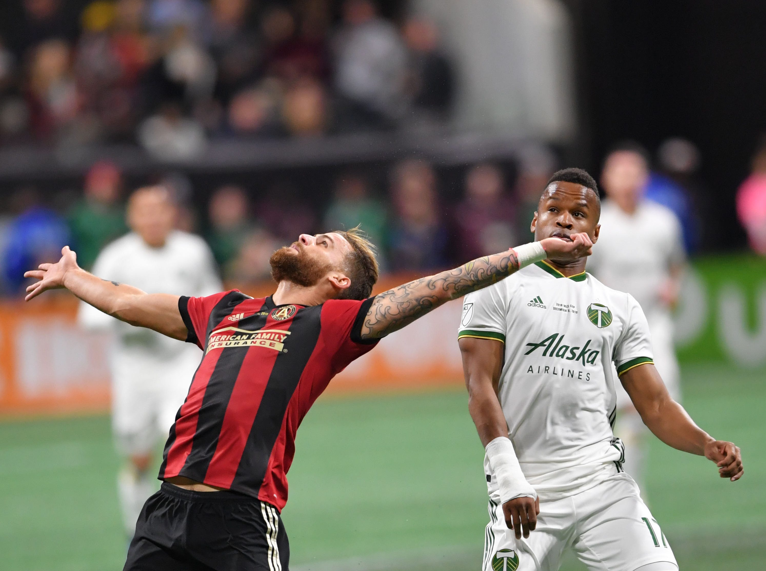 Atlanta United defender Leandro Gonzalez Pirez (5) heads the ball as Portland Timbers forward Jeremy Ebobisse (17) gives chase during the first half in the 2018 MLS Cup.