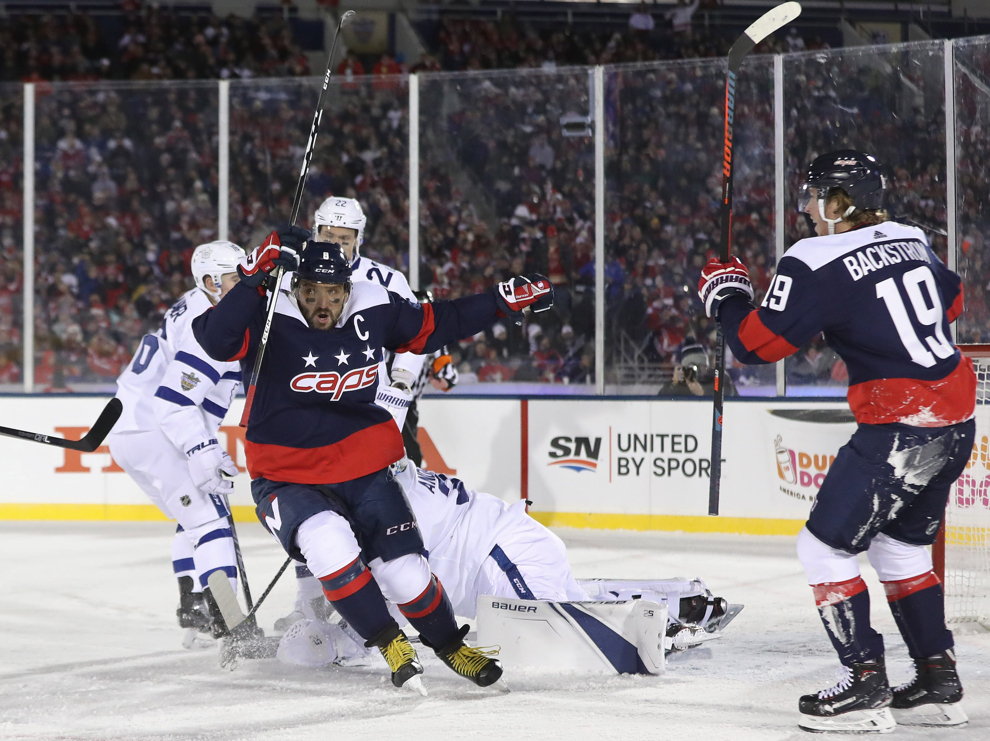 March 3: Washington Capitals left wing Alex Ovechkin (8) celebrates after scoring a goal on Toronto Maple Leafs goaltender Frederik Andersen (31) in the first period in a Stadium Series game at Navy-Marine Corps Memorial Stadium.