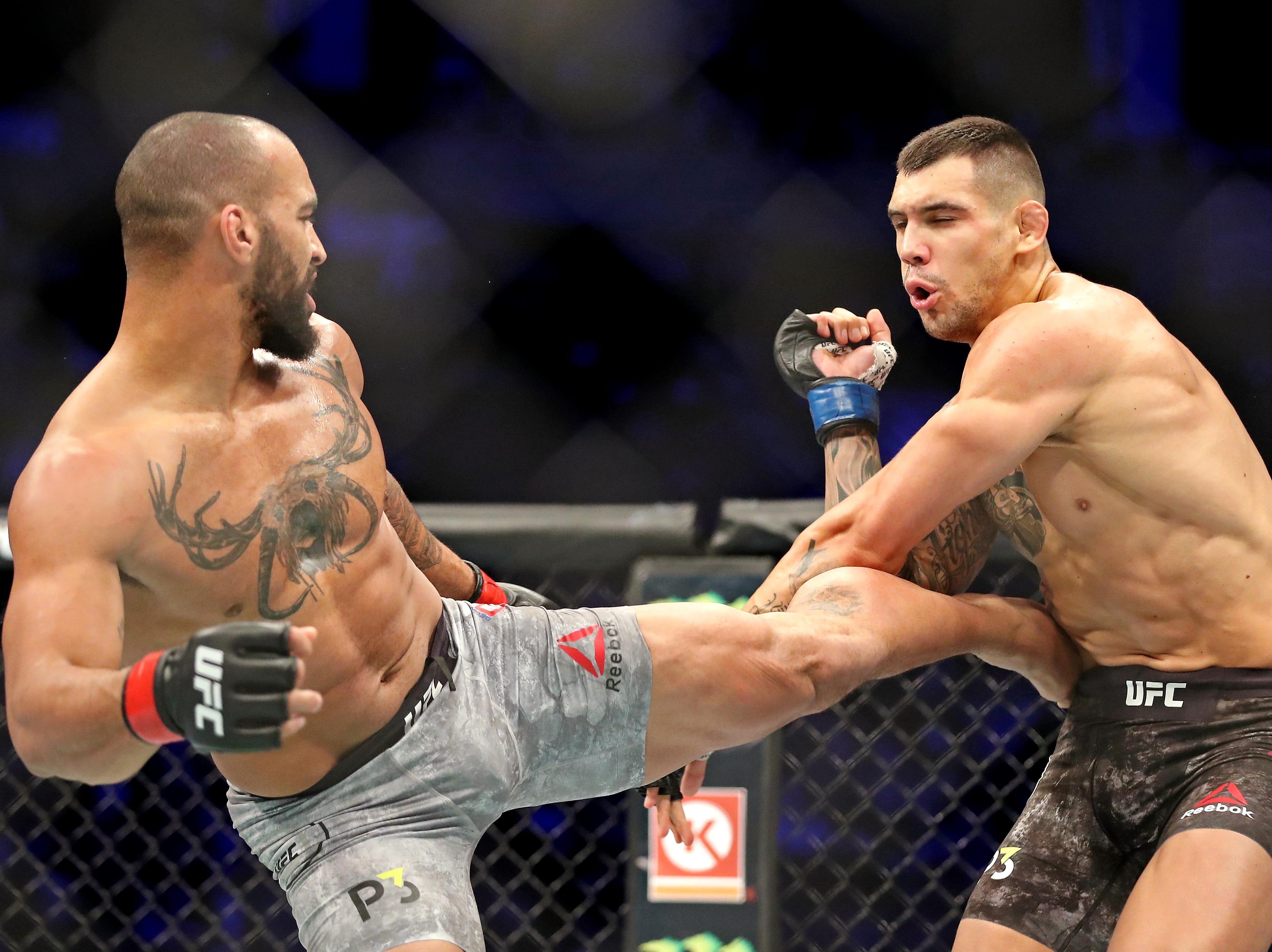 Devin Clark (red gloves) fights Aleksandar Rakic (blue gloves) during UFC 231 at Scotiabank Arena.