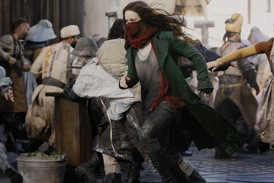 "Hera Hilmar wears her scarf mask as ""Mortal Engines"" heroine Hester Shaw, who hides her distinguishing facial scar."