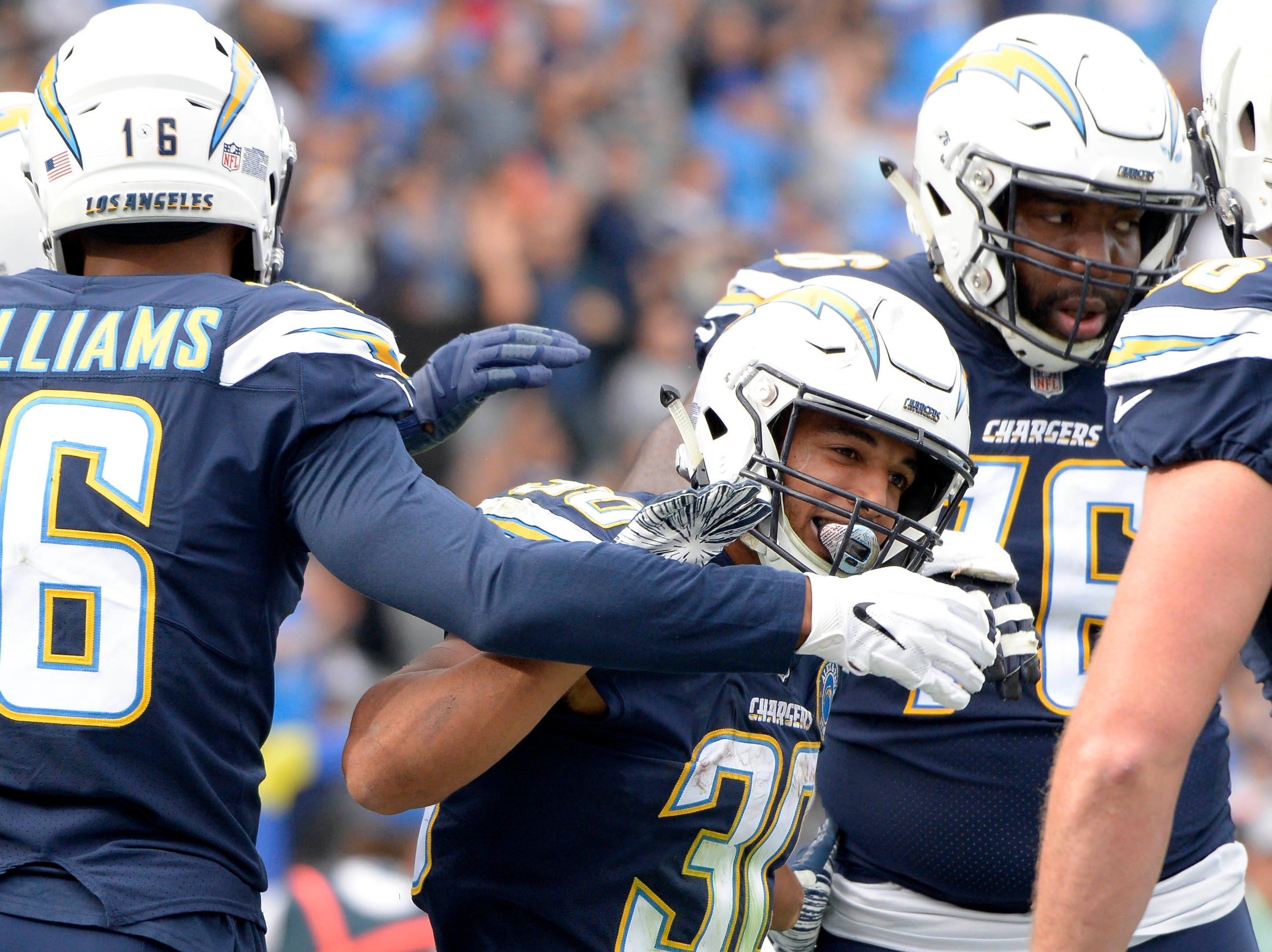 Chargers running back Austin Ekeler is congratulated after a second quarter touchdown against the Bengals.
