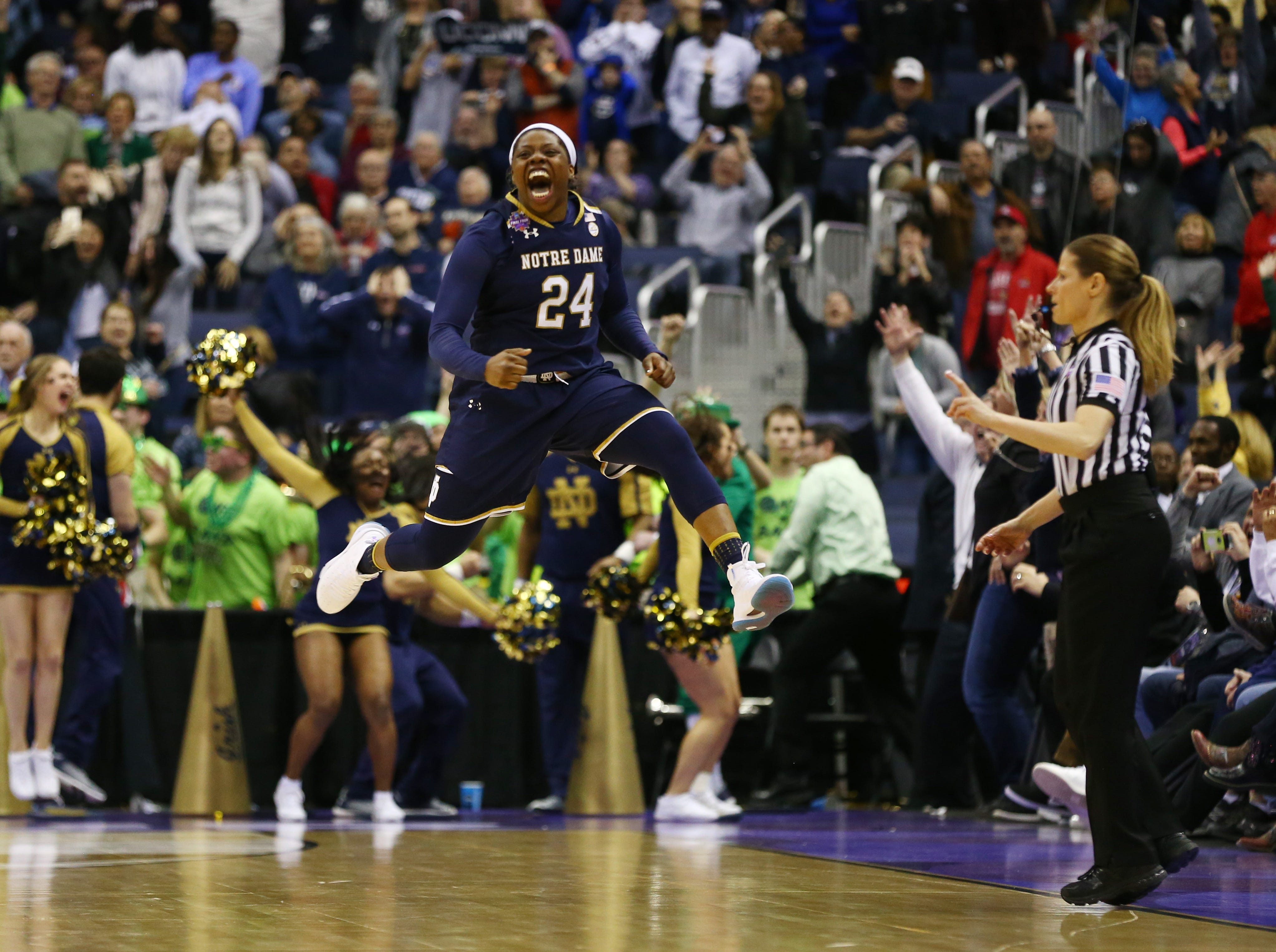 March 30: Notre Dame Fighting Irish guard Arike Ogunbowale (24) reacts after hitting the game-winning shot against the Connecticut Huskies in overtime of their Final Four game.