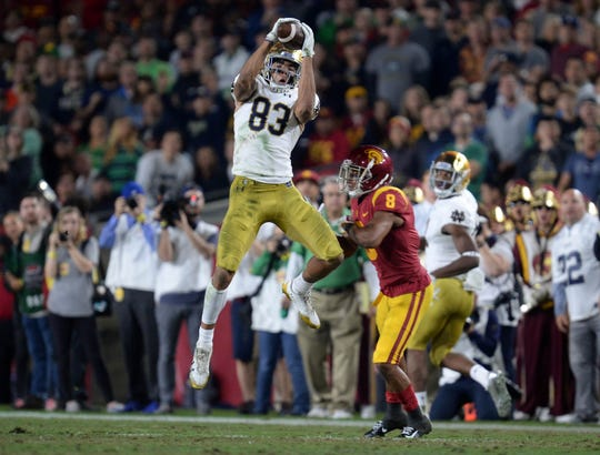 November 24, 2018; Los Angeles, CA, USA; Notre Dame Fighting Irish wide receiver Chase Claypool (83) catches a pass in front of Southern California Trojans cornerback Iman Marshall (8) during the first half at the Los Angeles Memorial Coliseum. Mandatory Credit: Gary A. Vasquez-USA TODAY Sports