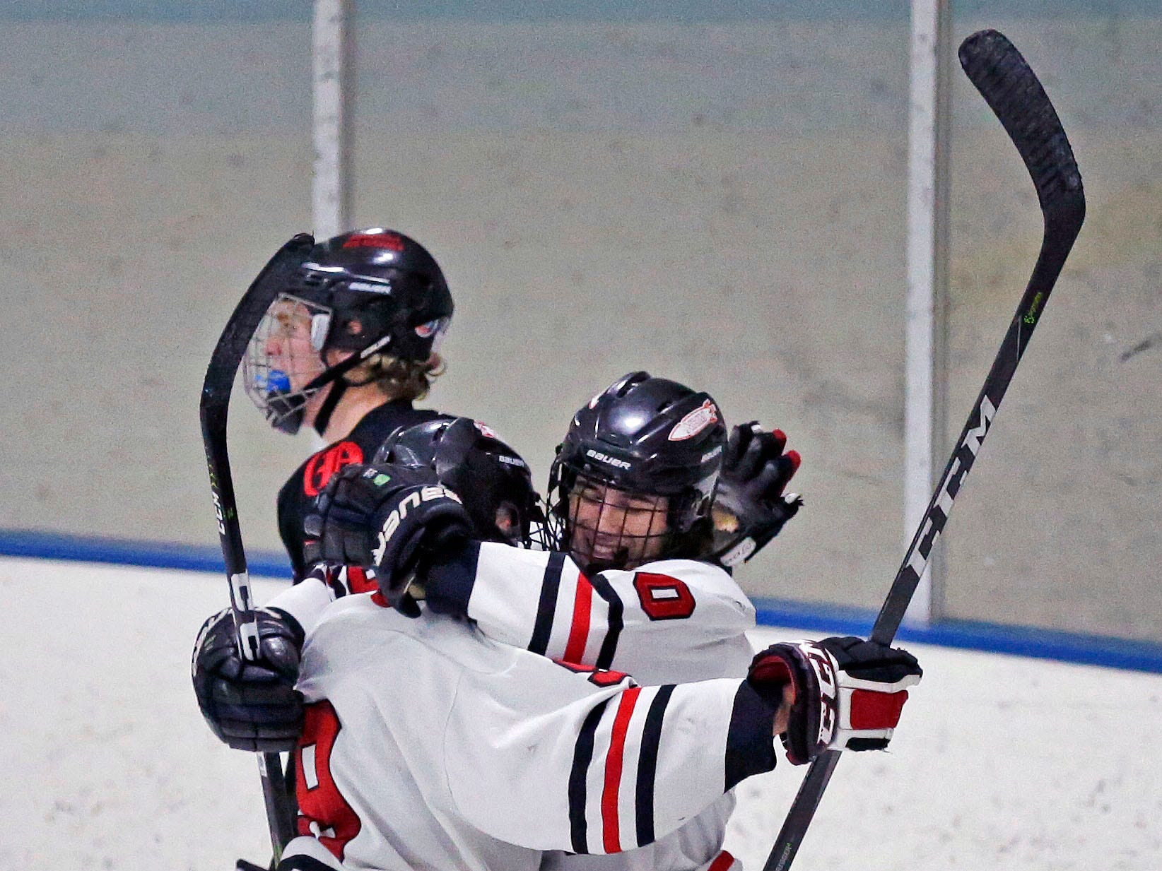 Dillon Fox and Cody Dias of Neenah/Hortonville/Menasha celebrate a goal against Oshkosh in a Badgerland Conference hockey game Tuesday, December 4, 2018, at Tri-County Ice Arena in Fox Crossing, Wis.
