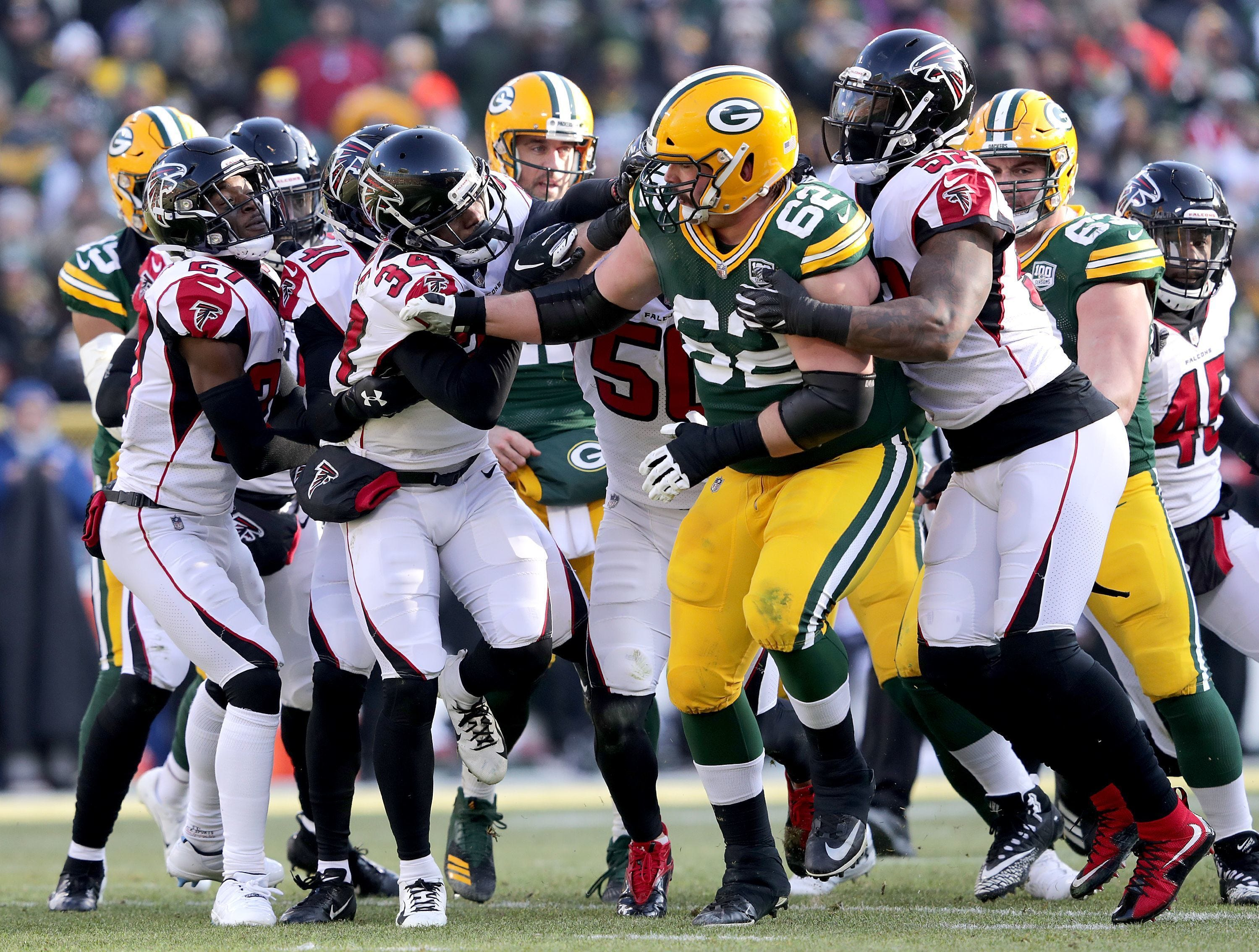 A scuffle after Atlanta Falcons cornerback Brian Poole tackled Green Bay Packers quarterback Aaron Rodgers in the second quarter of the Green Bay Packers against the Atlanta Falcons during their football game on Sunday, December 9, 2018, at Lambeau Field in Green Bay, Wis.