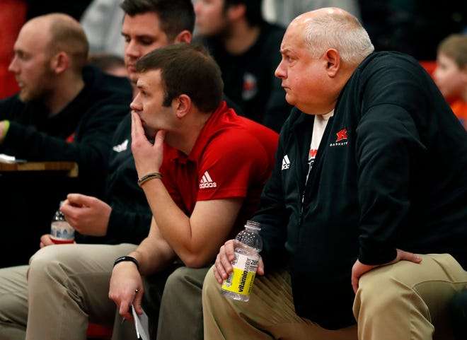 Kimberly High School assistant coach John Mielke, right, watches from the bench during Friday's game against Kaukauna.