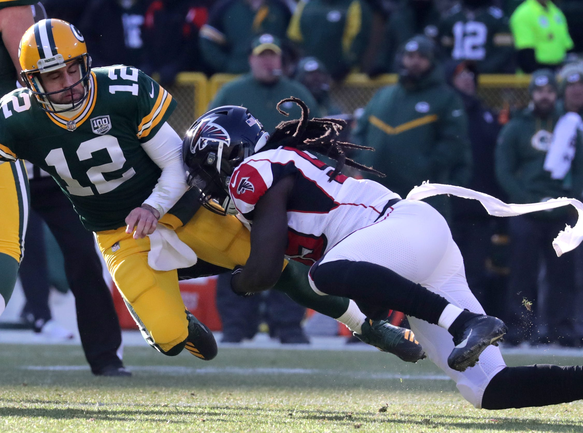Green Bay Packers quarterback Aaron Rodgers is sacked by Atlanta Falcons outside linebacker De'Vondre Campbell in the first half during their football game on Sunday, December 9, 2018, at Lambeau Field in Green Bay, Wis.