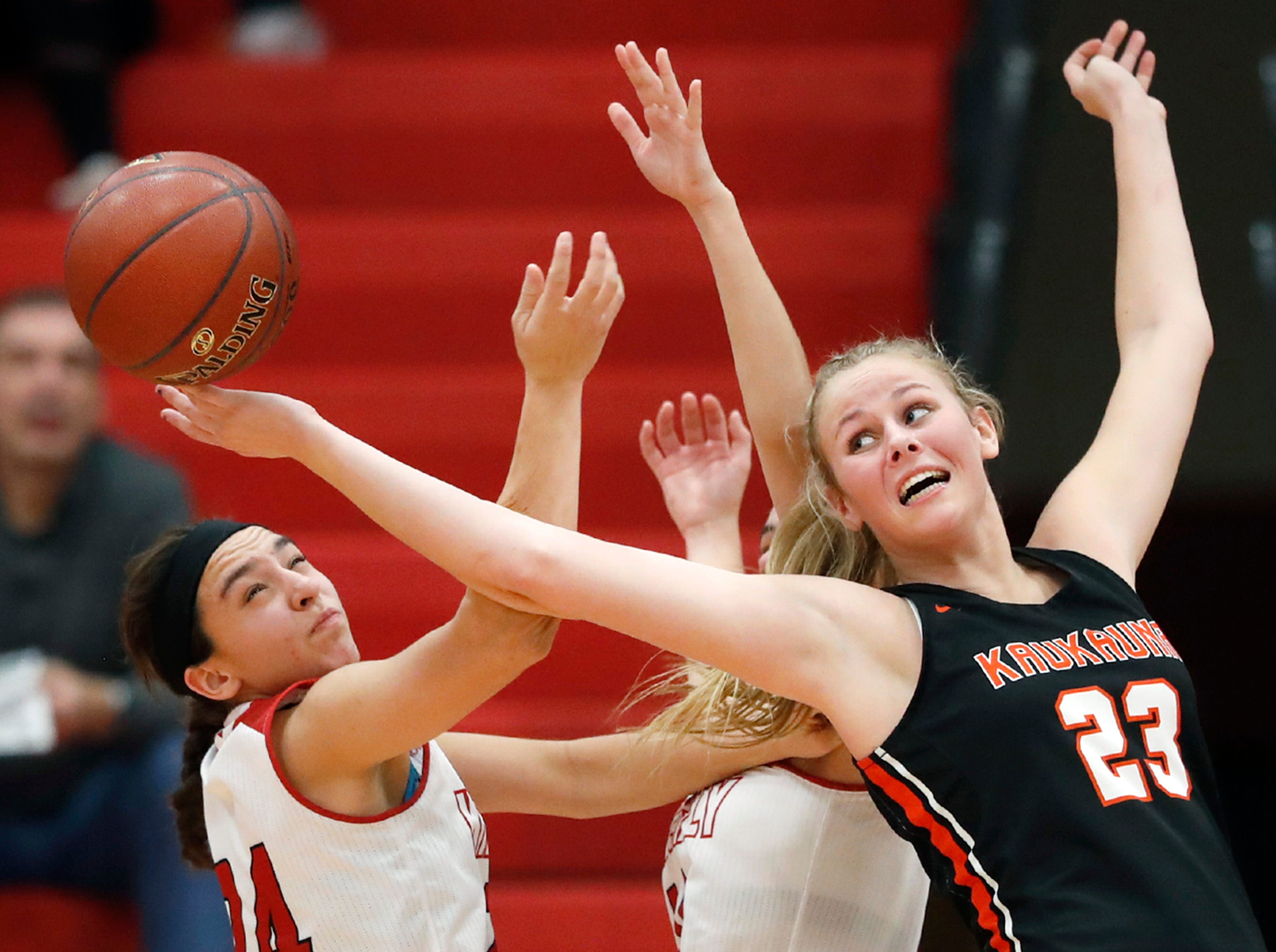 Kaukauna High School's Avery Torrey stretches for a ball during their game against Kimberly High School Friday, Dec. 7, 2018, in Kimberly, Wis. Kimberly High School defeated Kaukauna High School 70-55.