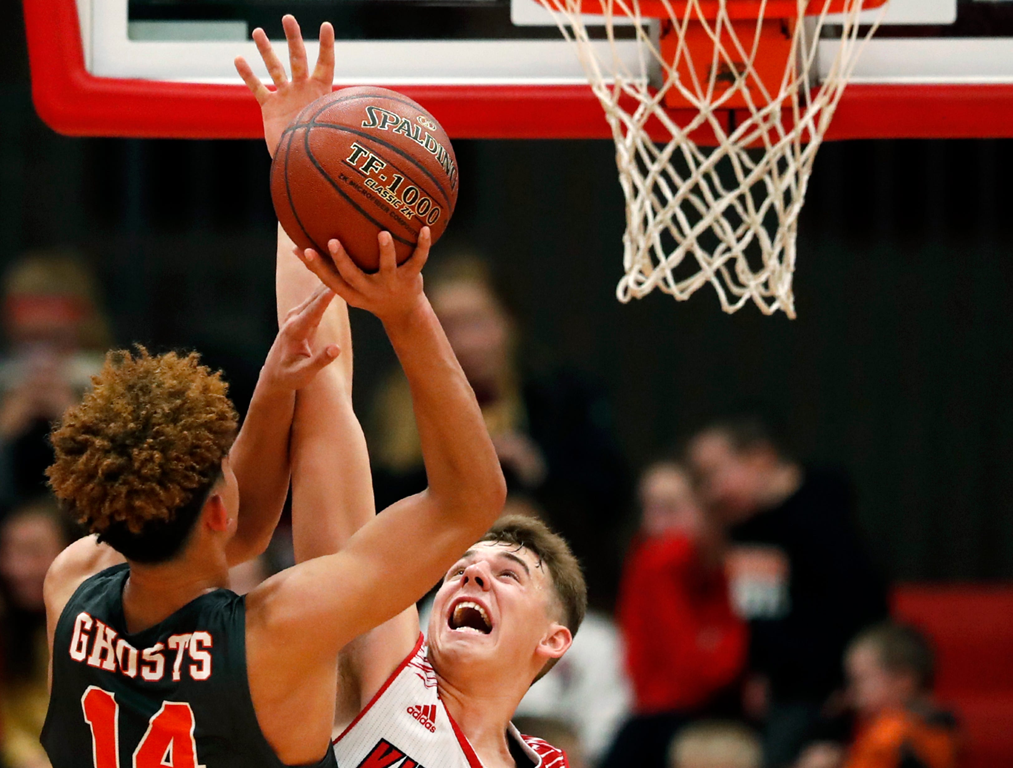 Kaukauna High School's Brayden Ivory tries to get a shot past Kimberly High School's Reed Miller Friday, Dec. 7, 2018, in Kimberly, Wis. Kimberly High School defeated Kaukauna High School 85-64.